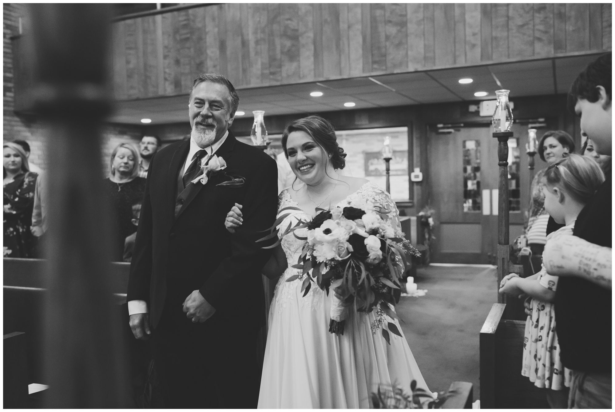bride walks down aisle with father during wedding ceremony at Zion Lutheran Church in Decatur