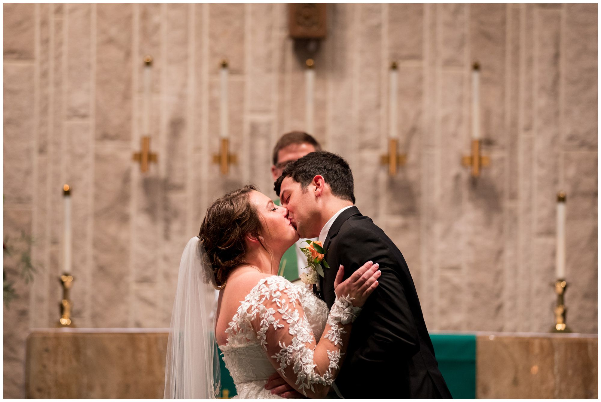 bride and groom first kiss during wedding ceremony at Zion Lutheran Church in Decatur