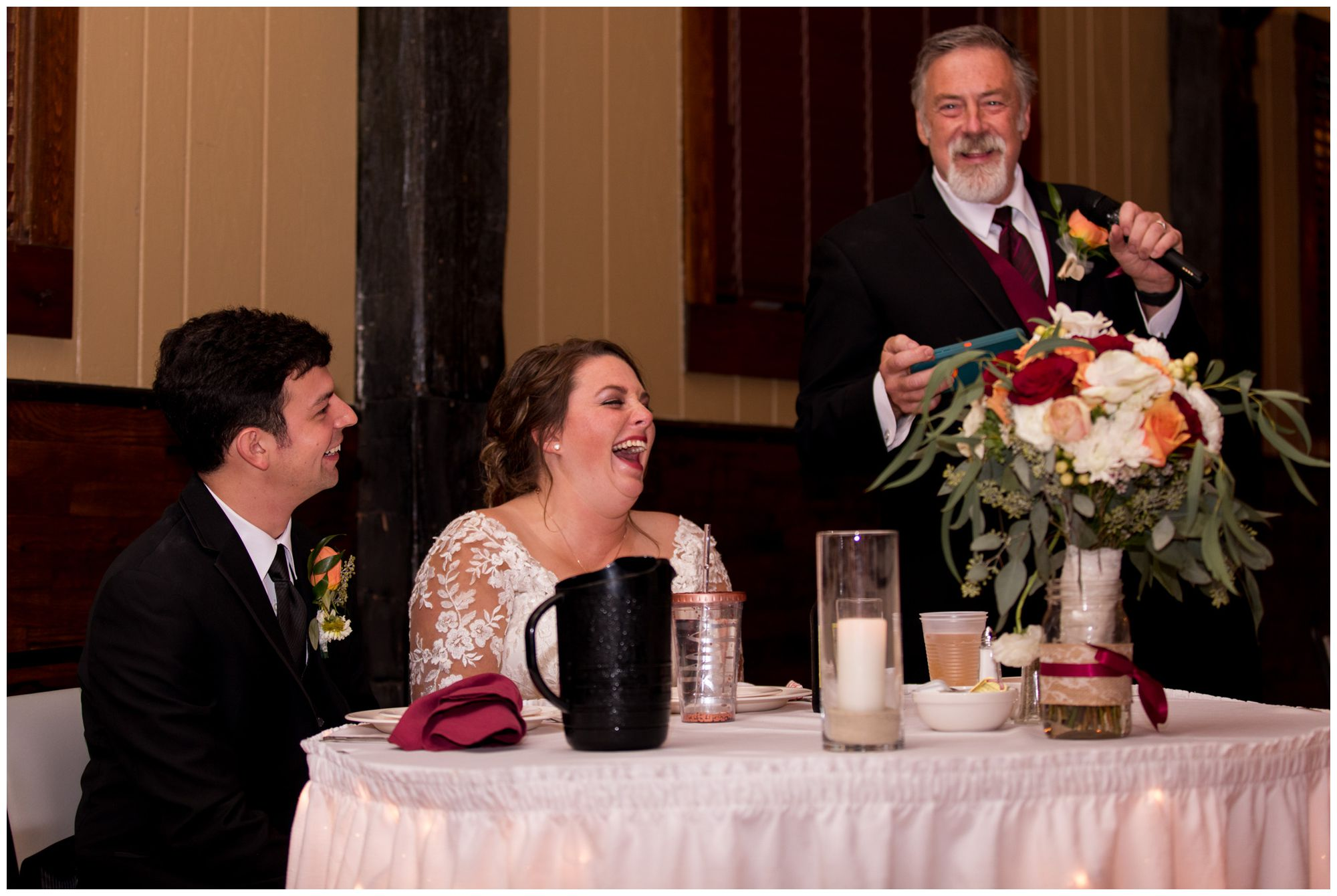 bride and groom laugh during father's welcome speech at Goeglein Homestead