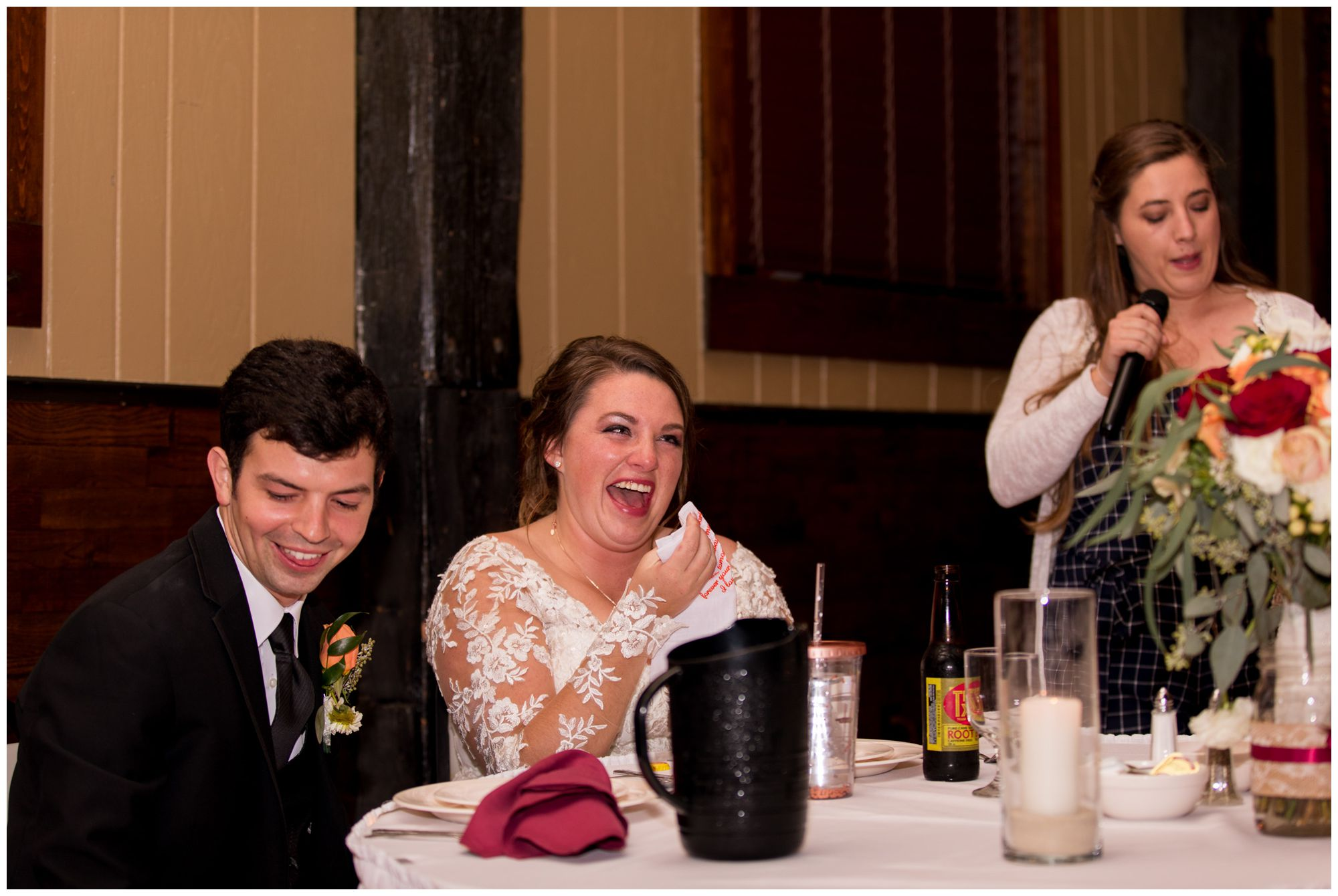 bride cries and laughs during wedding reception at Goeglein Homestead in Fort Wayne