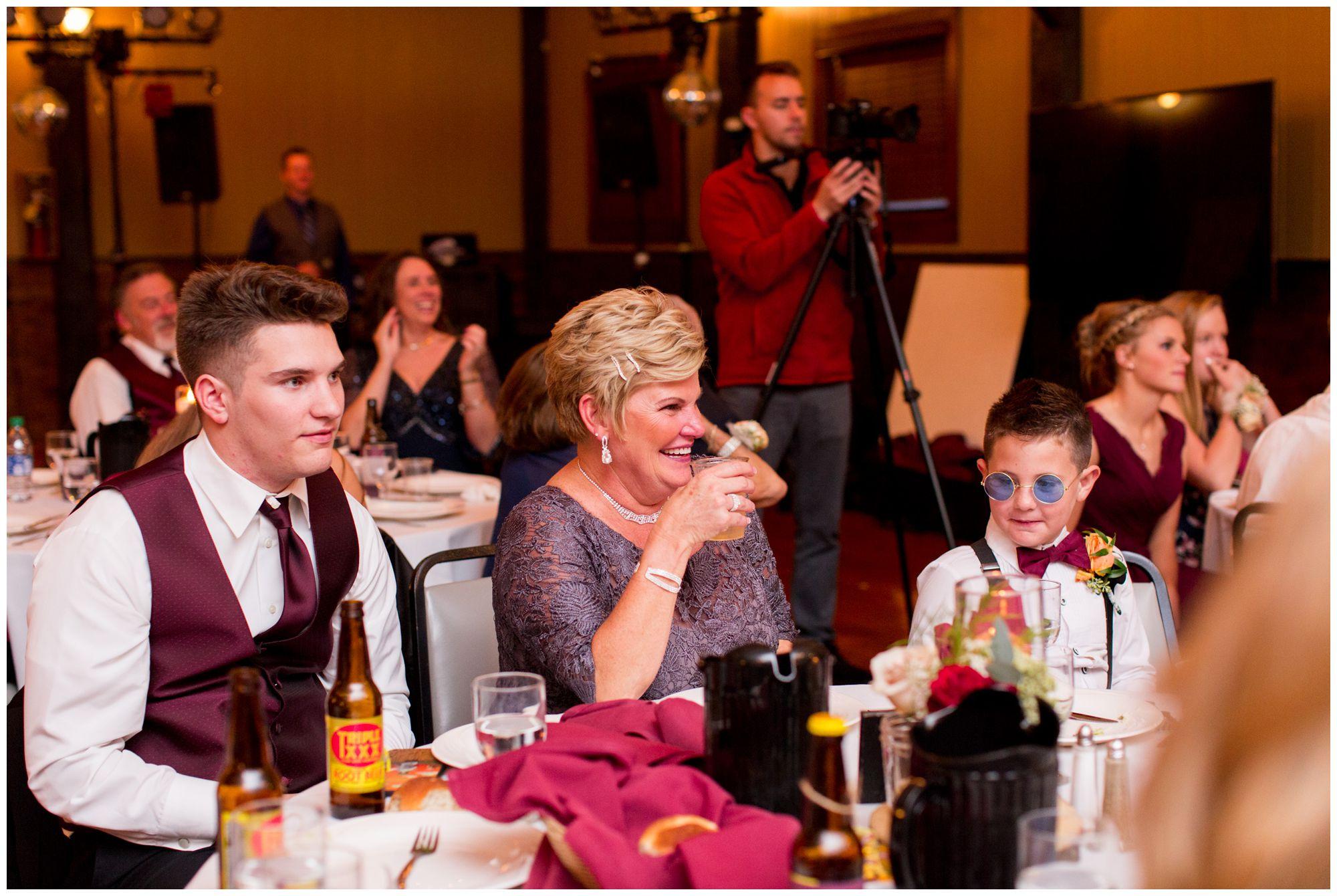 bride's mom smiles during toasts at Goeglein Homestead wedding reception