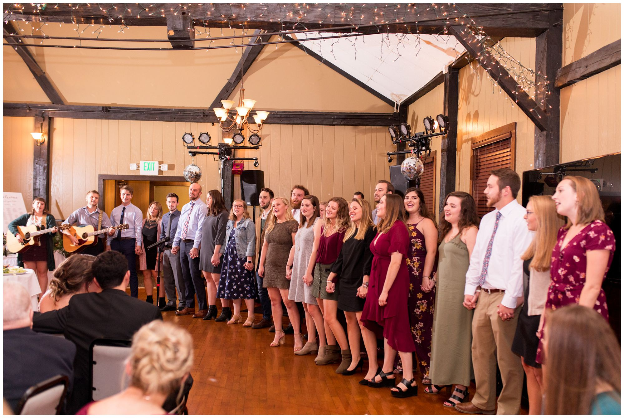 camp friends sing to Alexis and Josh during wedding reception at Goeglein Homestead