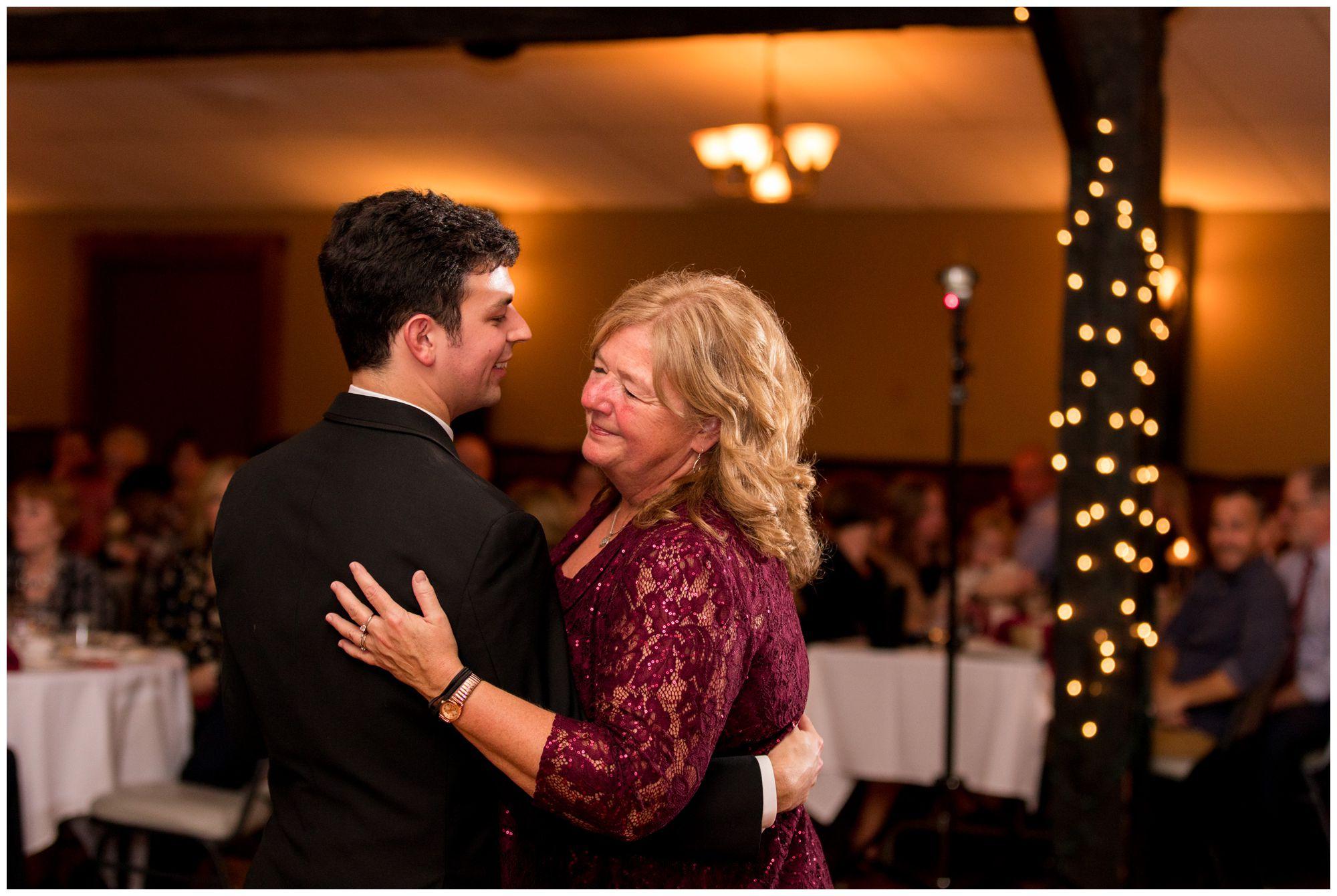 groom dances with mom during Goeglein Homestead Fort Wayne Indiana wedding reception