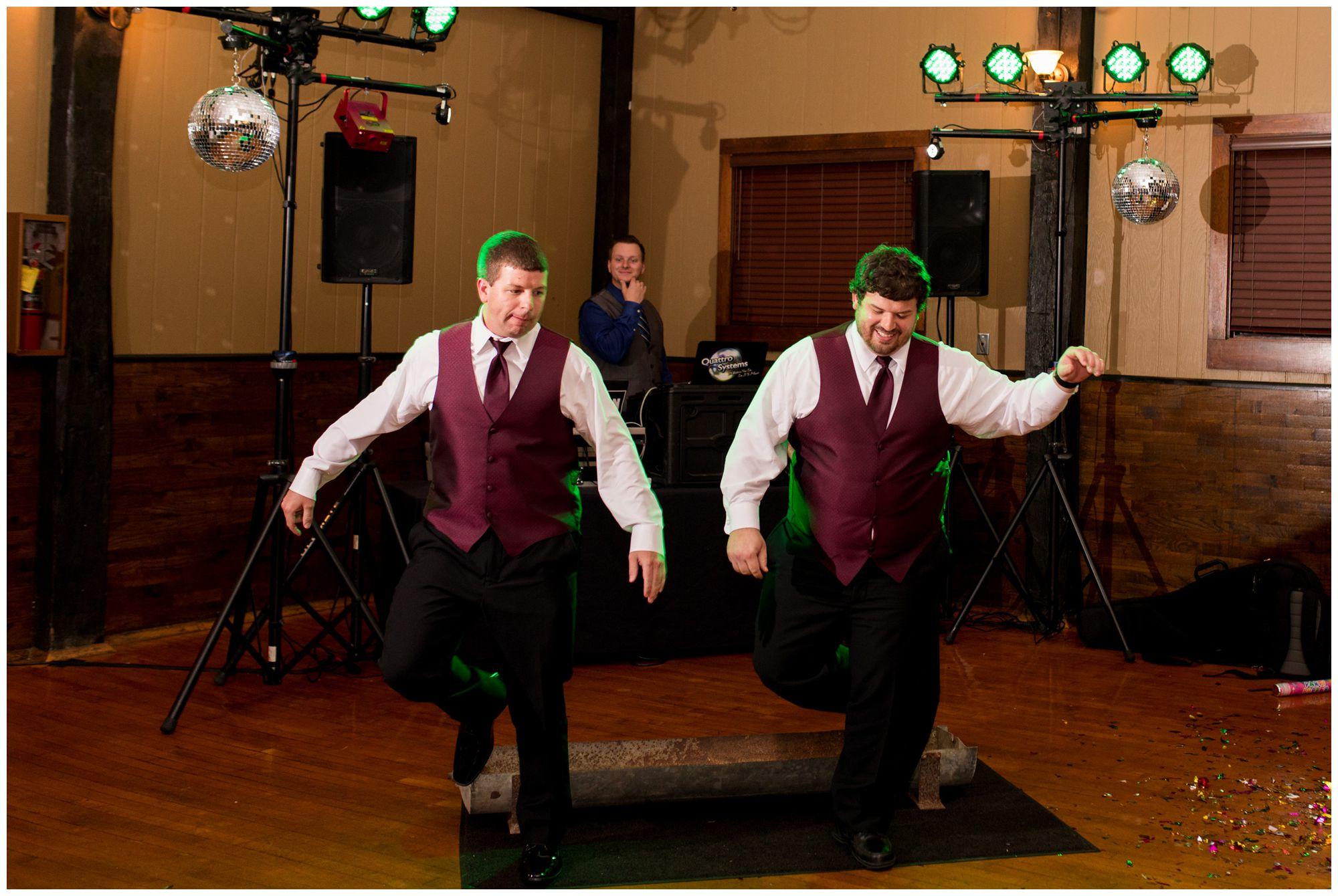 groom's brothers dance around hog trough during wedding reception at Goeglein Homestead