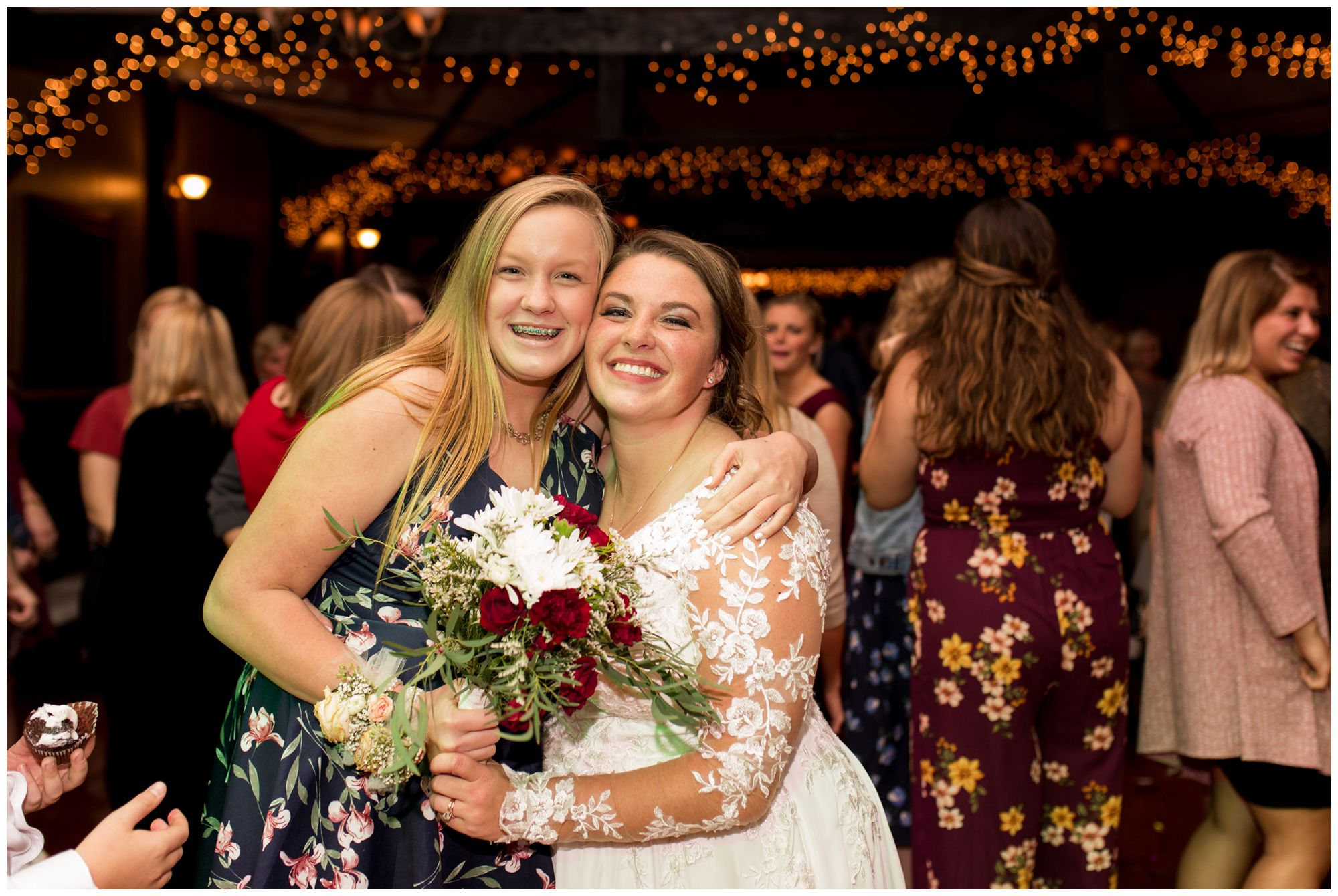 bride with friend after bouquet toss at Goeglein Homestead in Fort Wayne