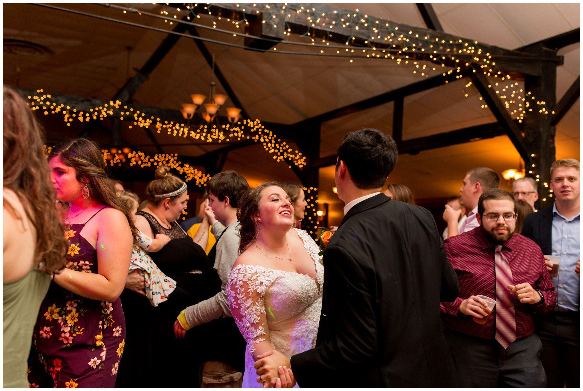 bride and groom dance during wedding reception at Goeglein Homestead in Fort Wayne