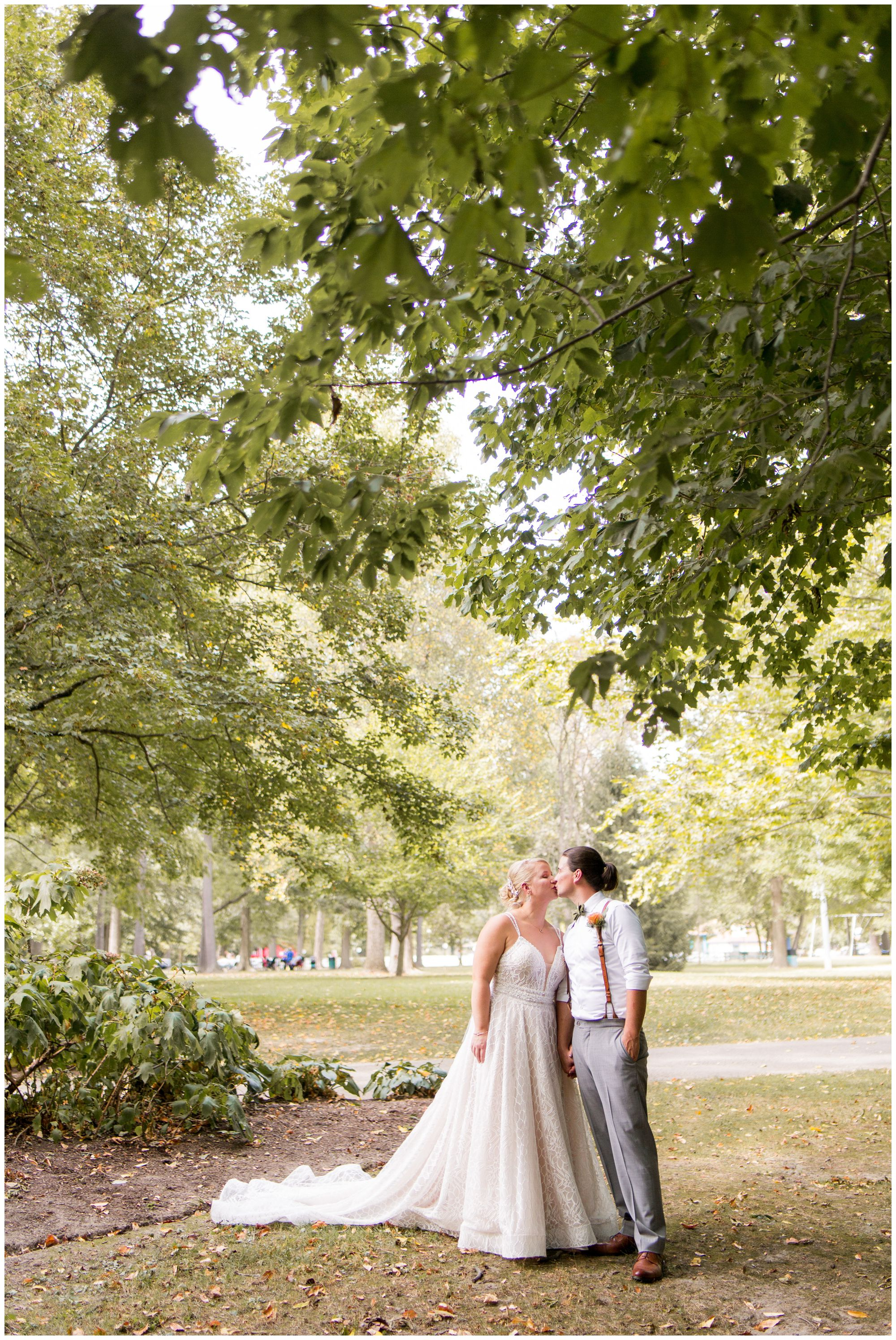 bride and groom kiss before wedding at Forest Park Inn in Noblesville