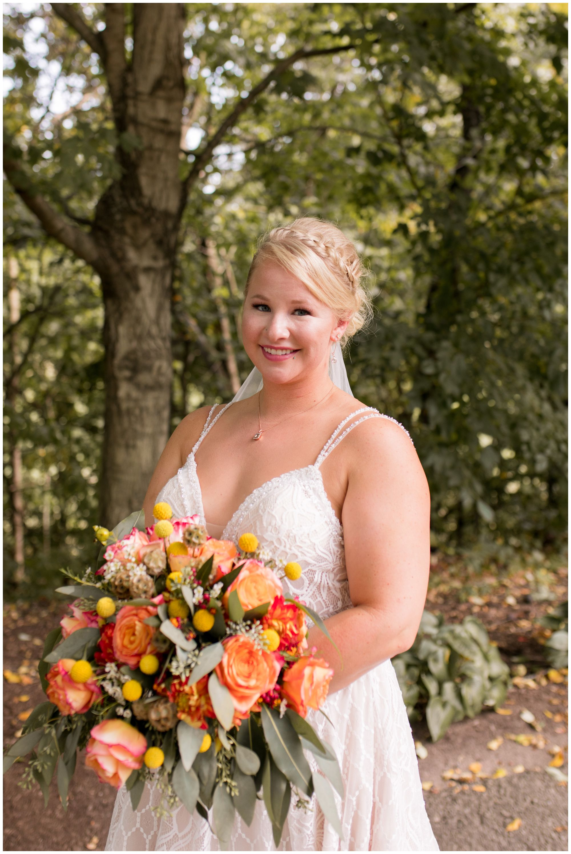 bride holds bouquet during wedding portraits in Noblesville Indiana
