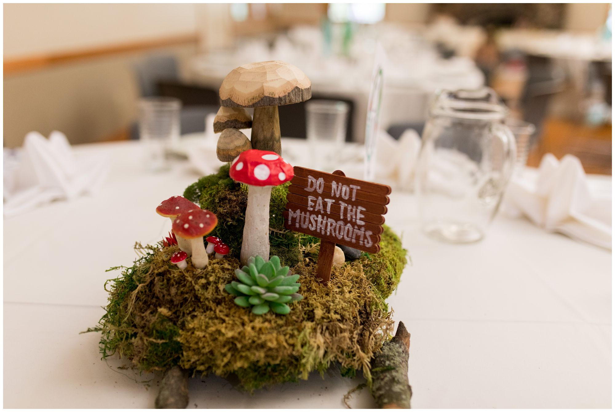 mushroom table centerpiece at Forest Park Inn wedding reception