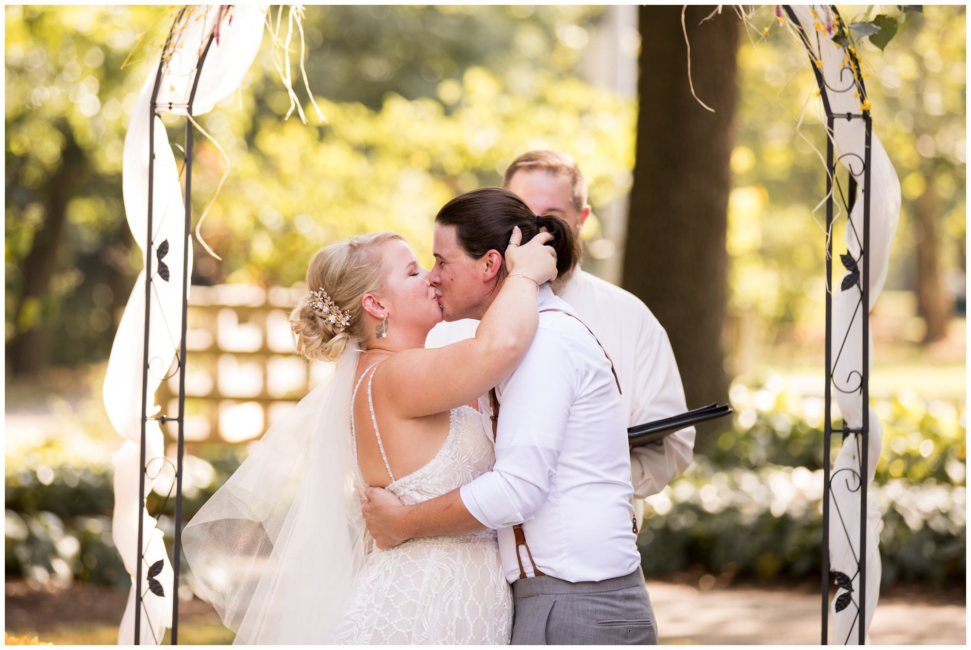 bride and groom first kiss during Forest Park Inn wedding ceremony