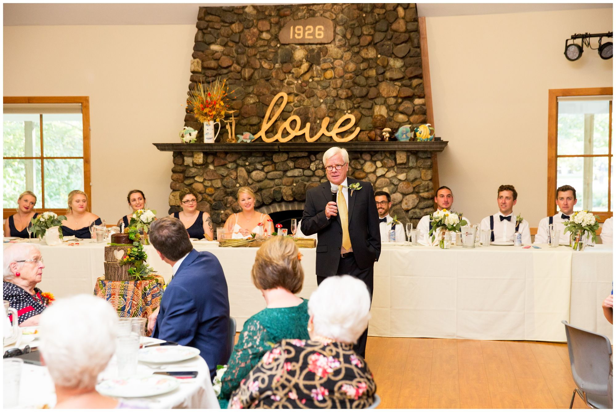 father of bride gives welcome speech at wedding reception at Forest Park Inn