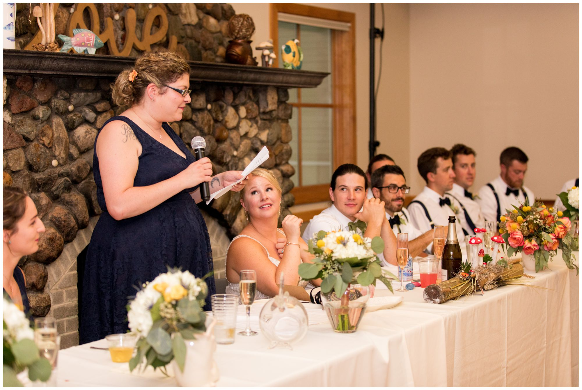maid of honor gives toast during Forest Park Inn wedding reception