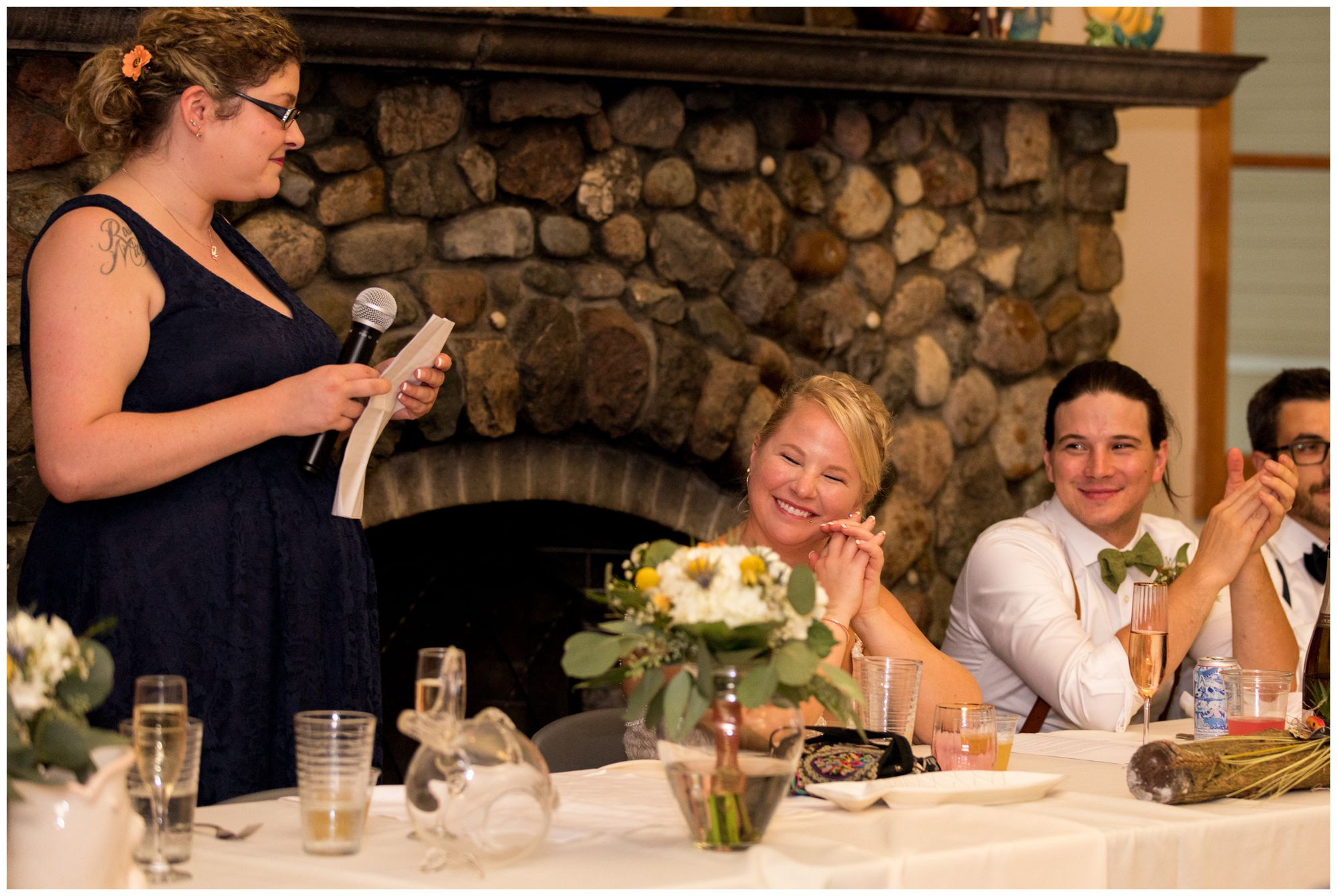 bride laughs during maid of honor toast at Forest Park Inn in Noblesville