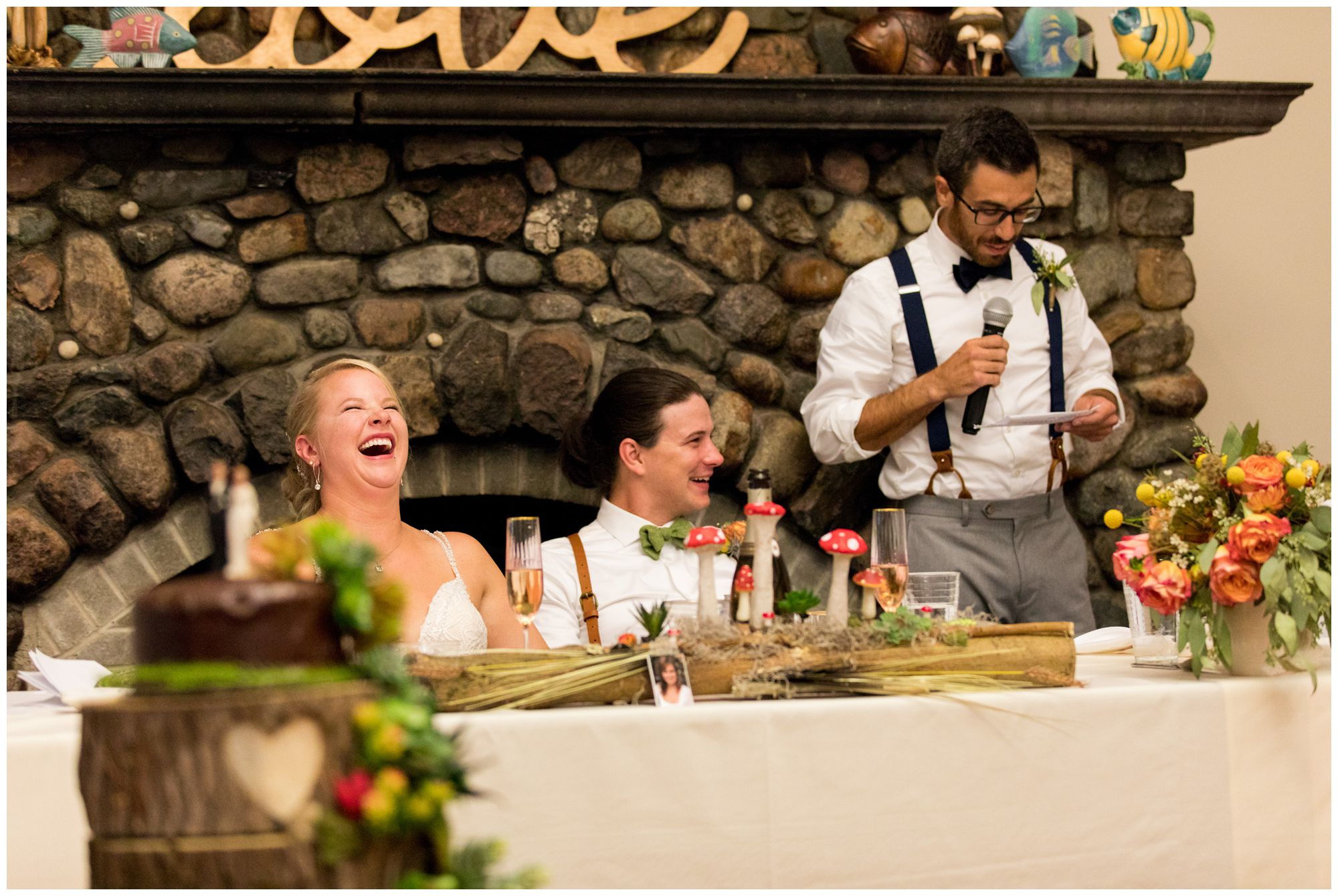bride and groom laugh during best man's speech at Forest Park Inn
