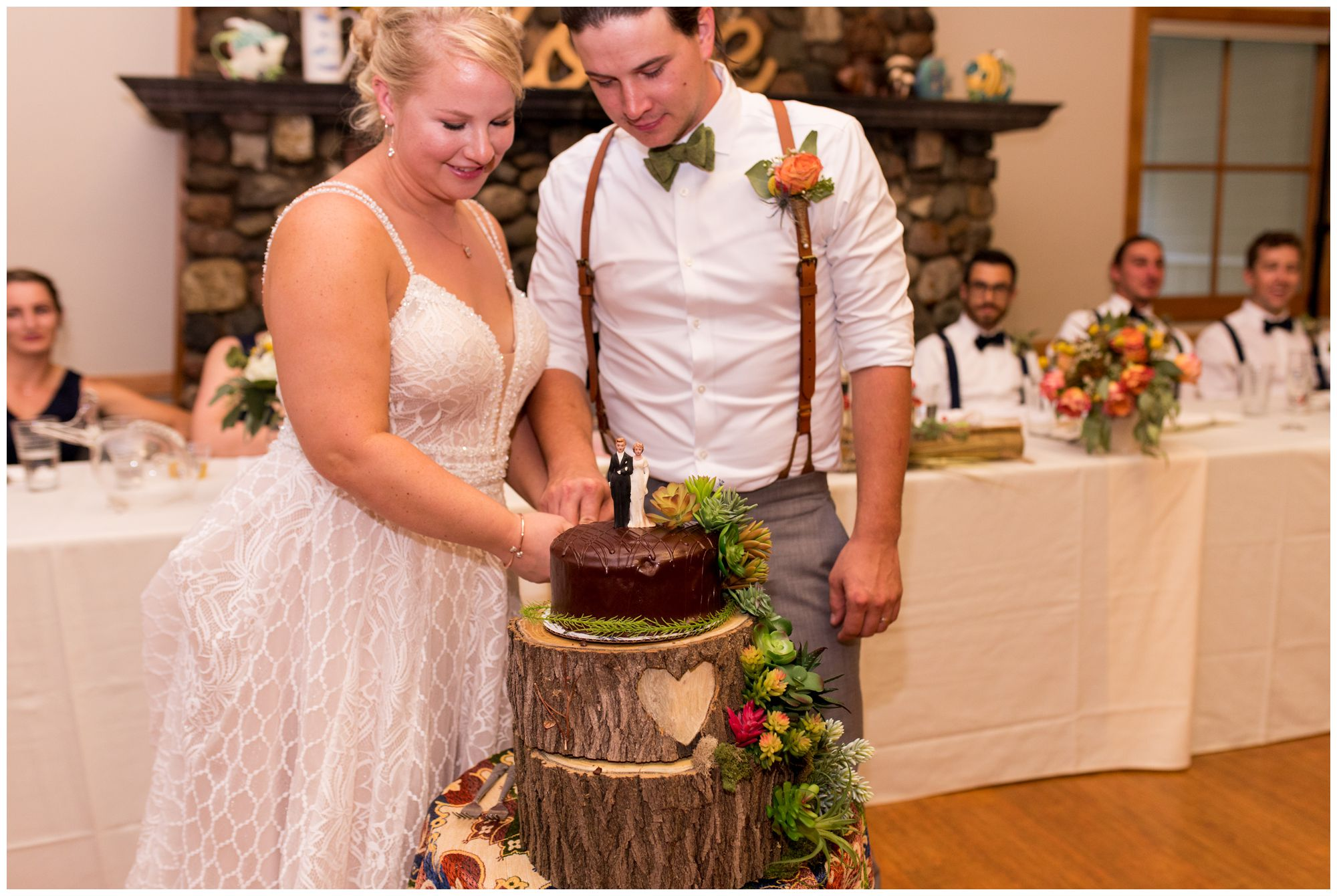 bride and groom cut cake during wedding reception at Forest Park Inn