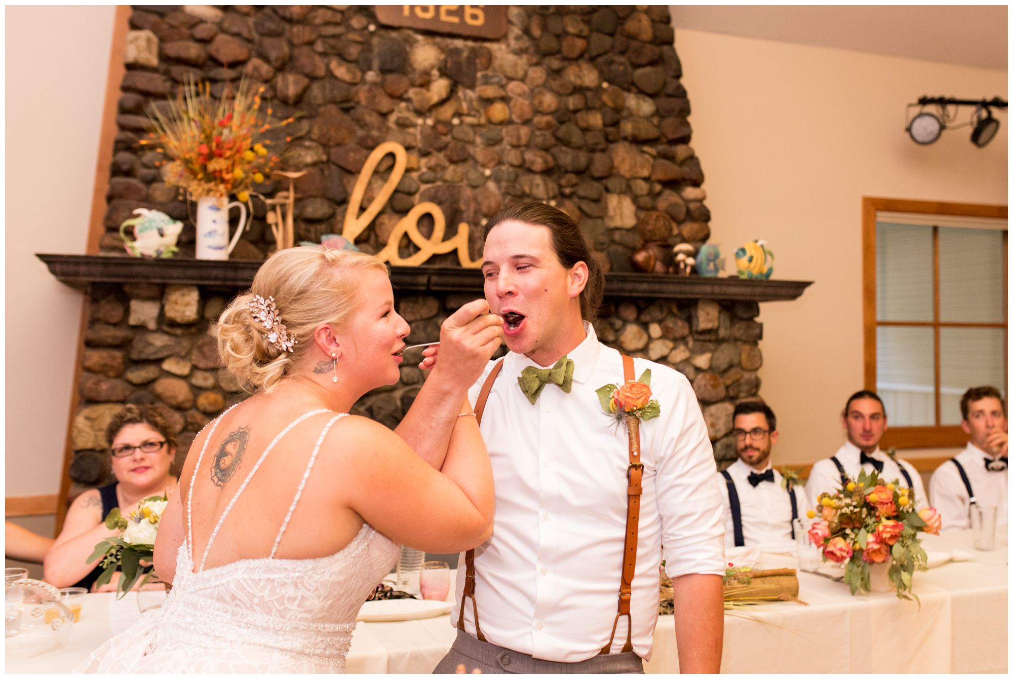 bride and groom eat cake during Forest Park Inn wedding reception