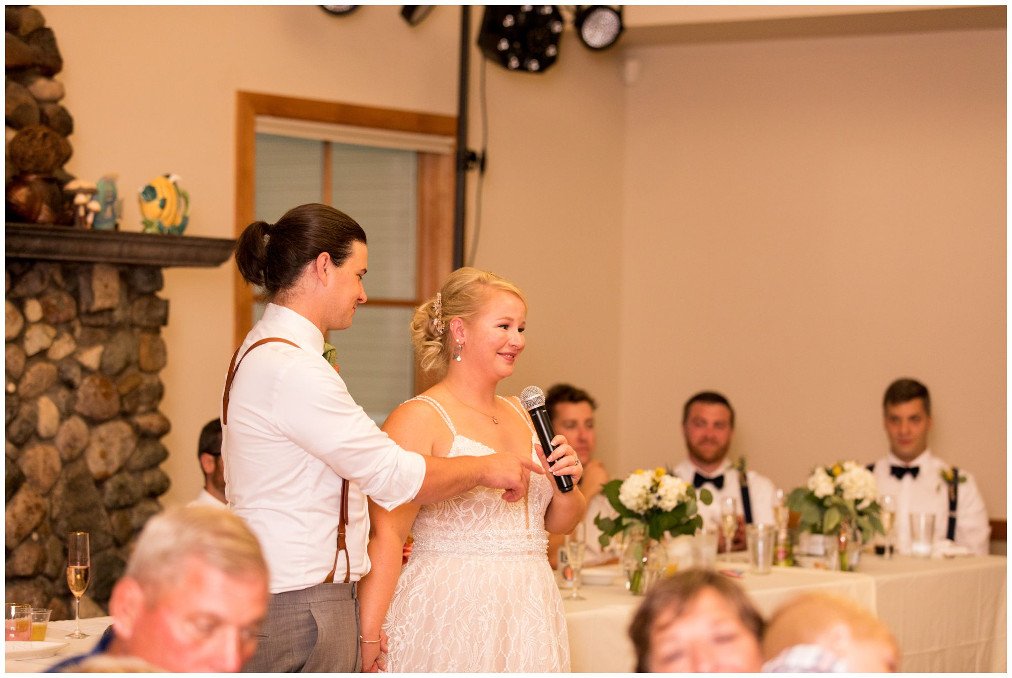 bride and groom thank guests for attending during wedding reception