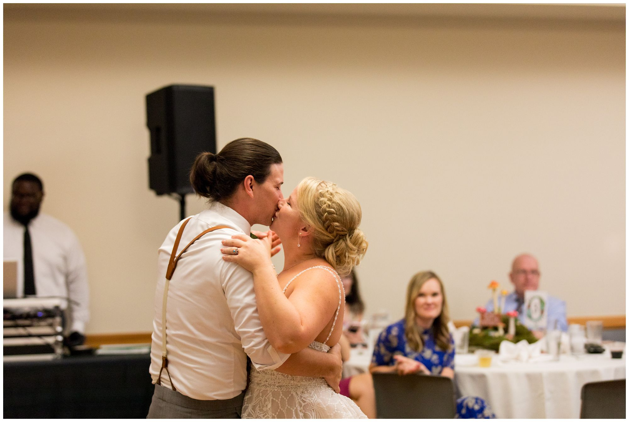 bride and groom kiss during first dance at Forest Park Inn reception