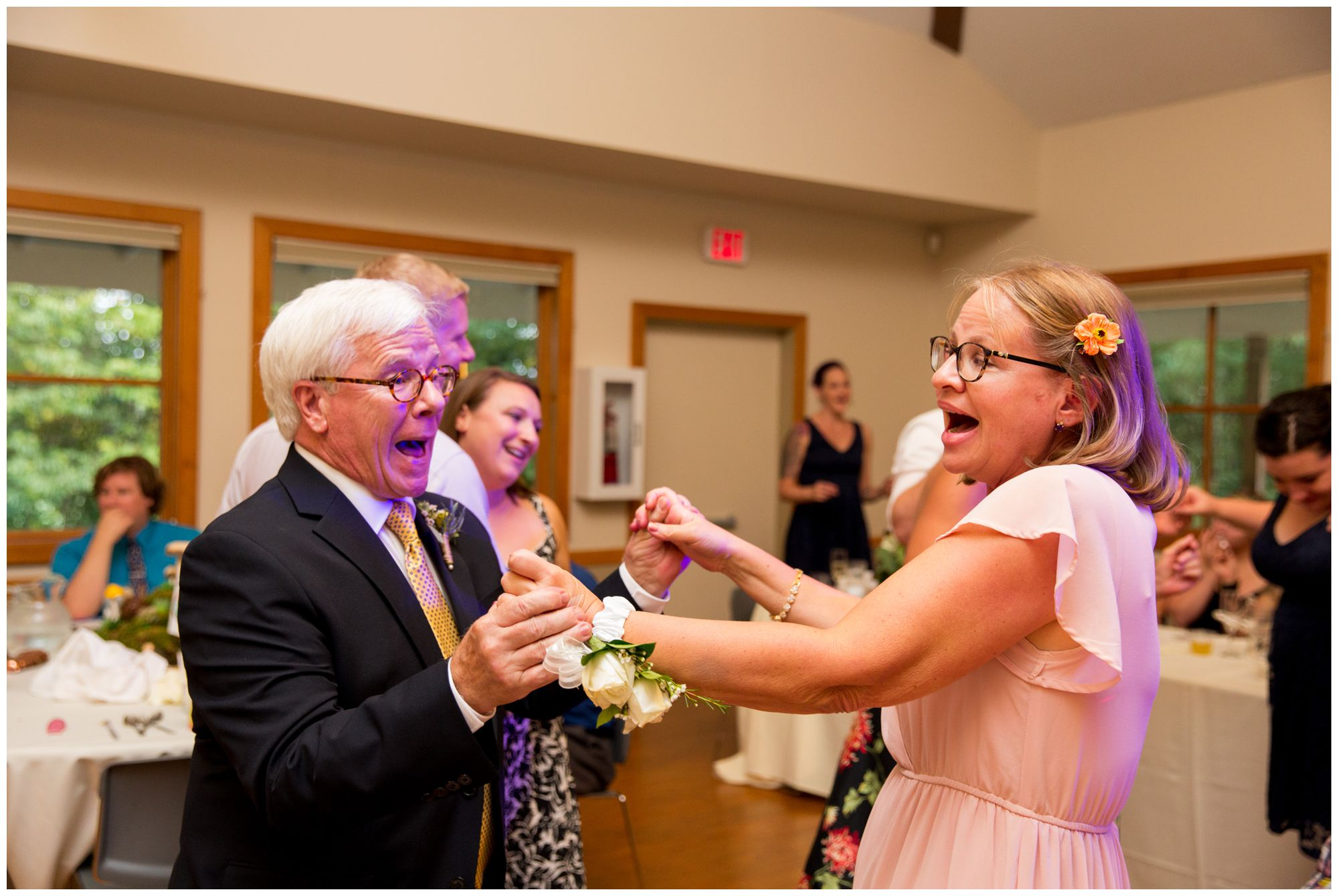 bride's parents dance during Forest Park Inn wedding reception