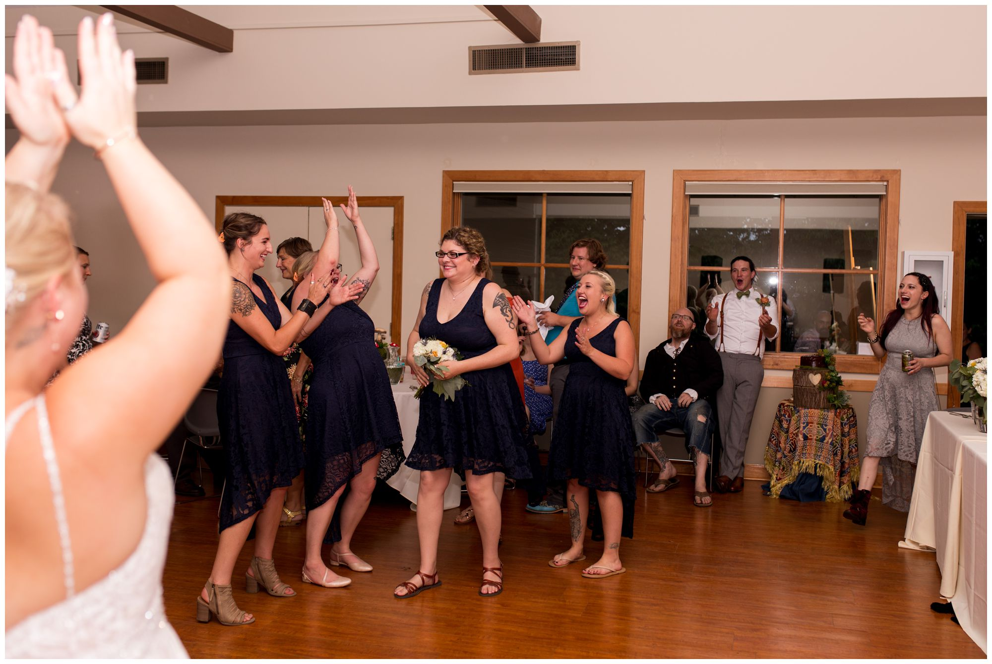 maid of honor catches bouquet during reception toss