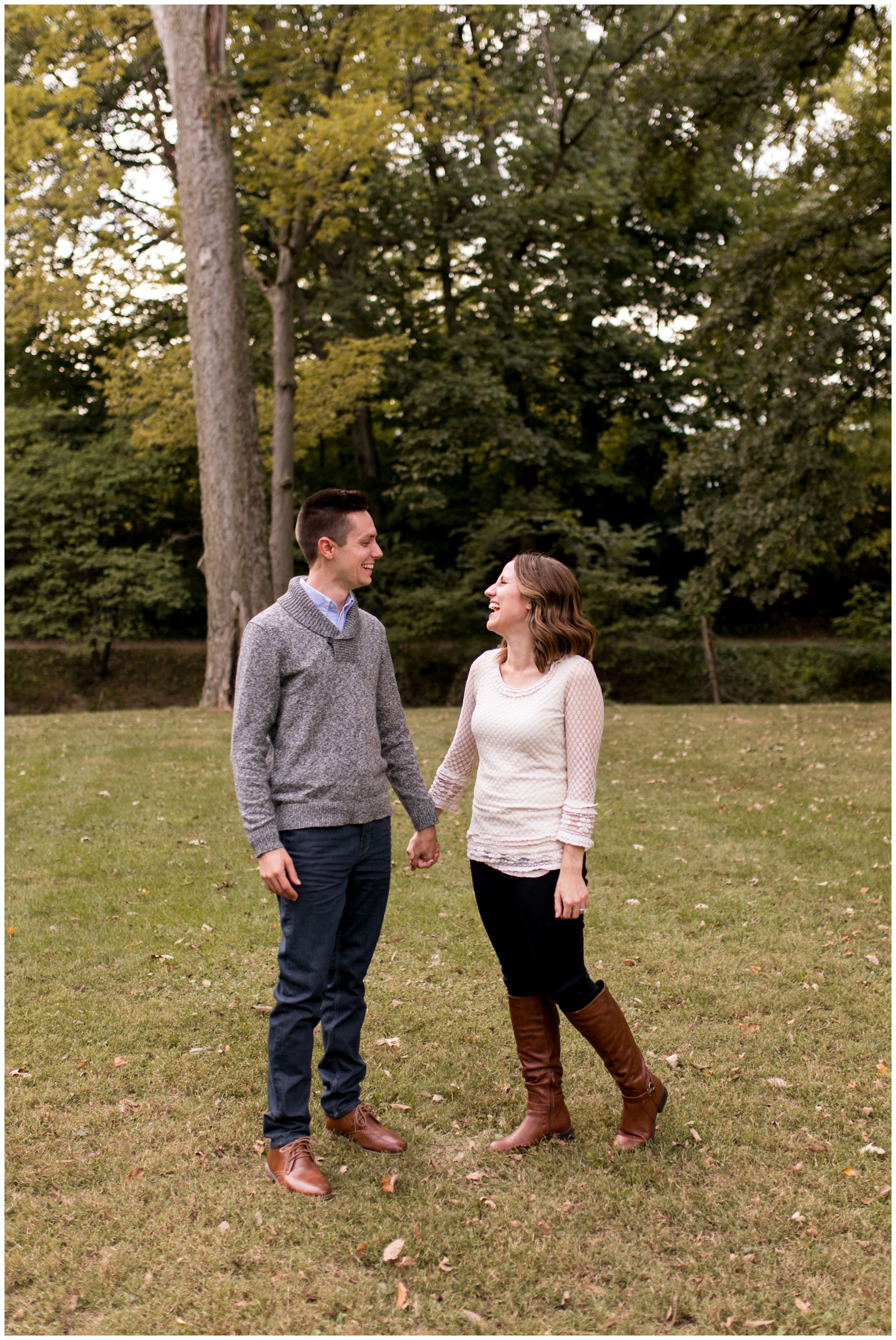 bride and groom hold hands during Highland Park engagement session in Kokomo Indiana