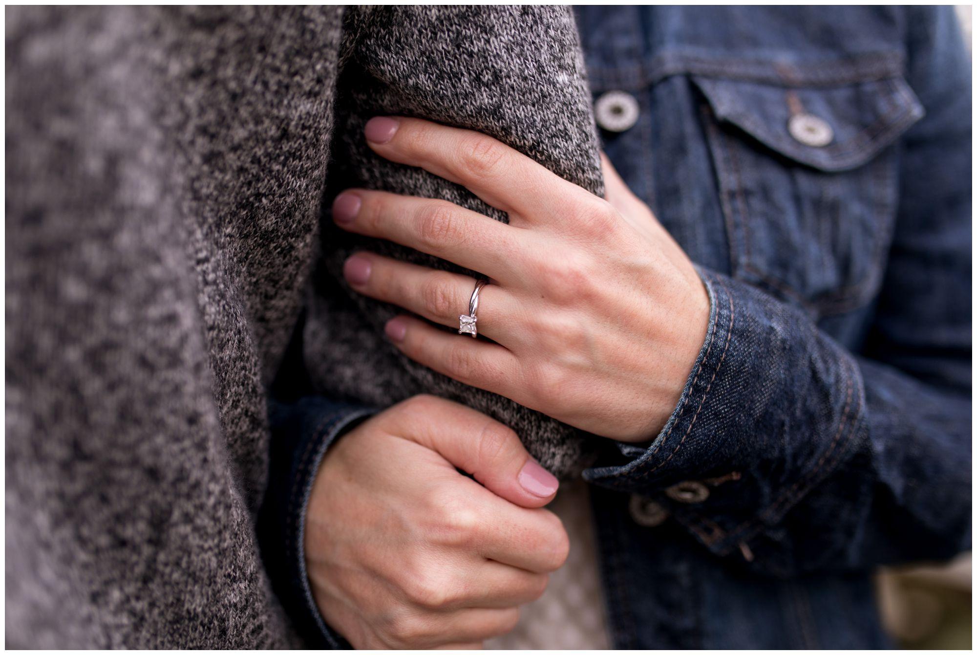 close up of bride's ring during engagement session at Kokomo Highland Park