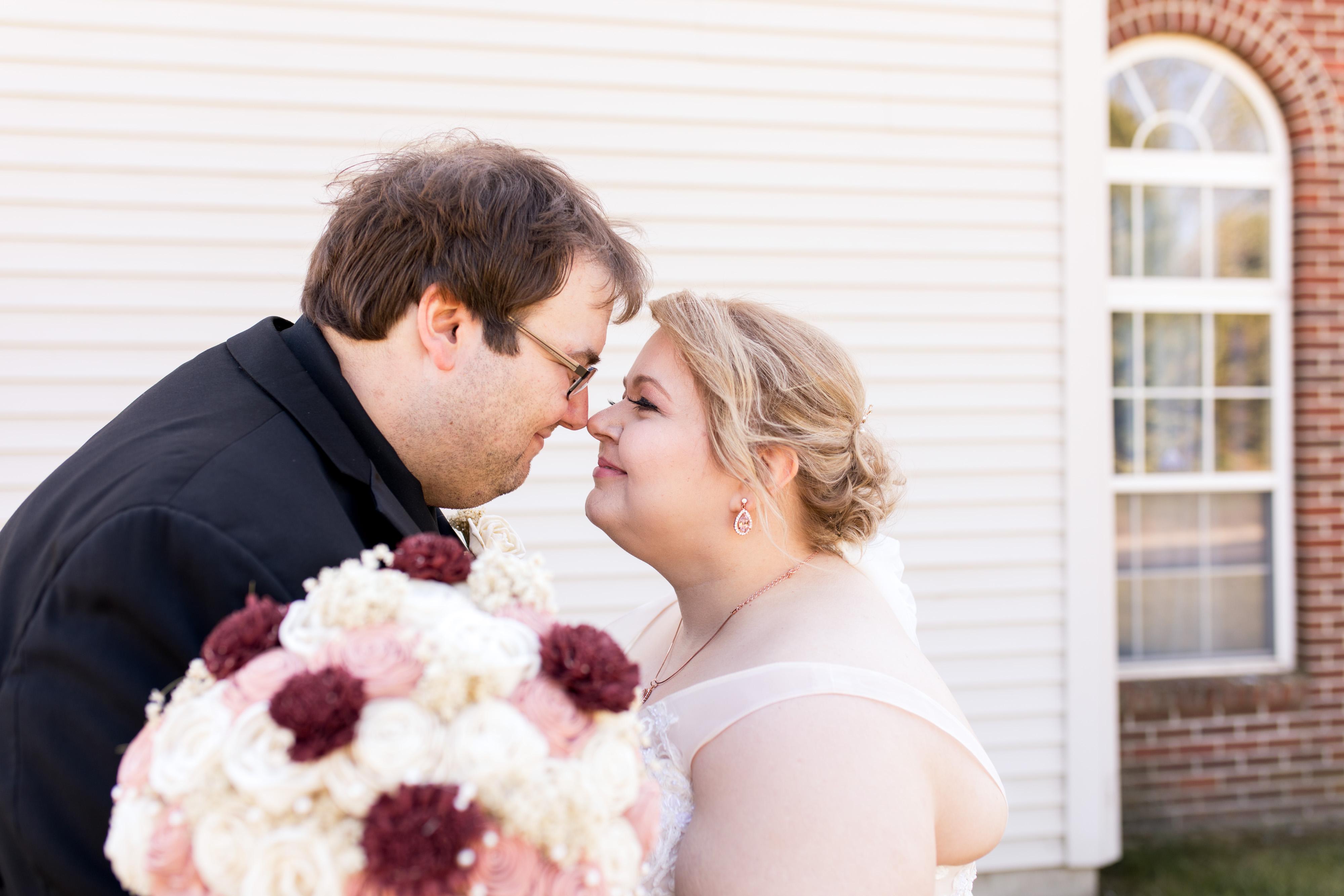 bride and groom nose to nose before Kokomo Indiana wedding