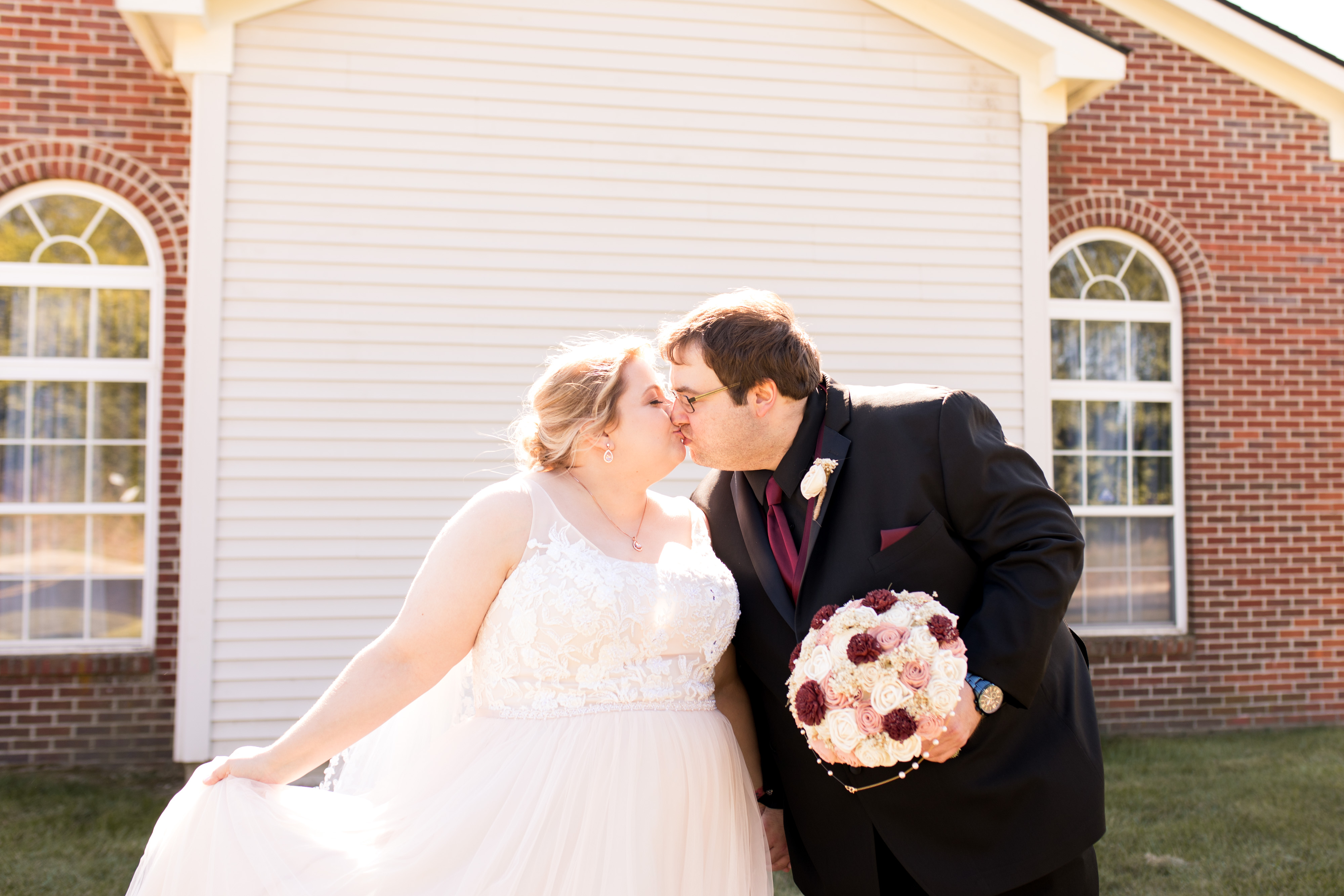 bride and groom kiss before wedding ceremony in Kokomo Indiana