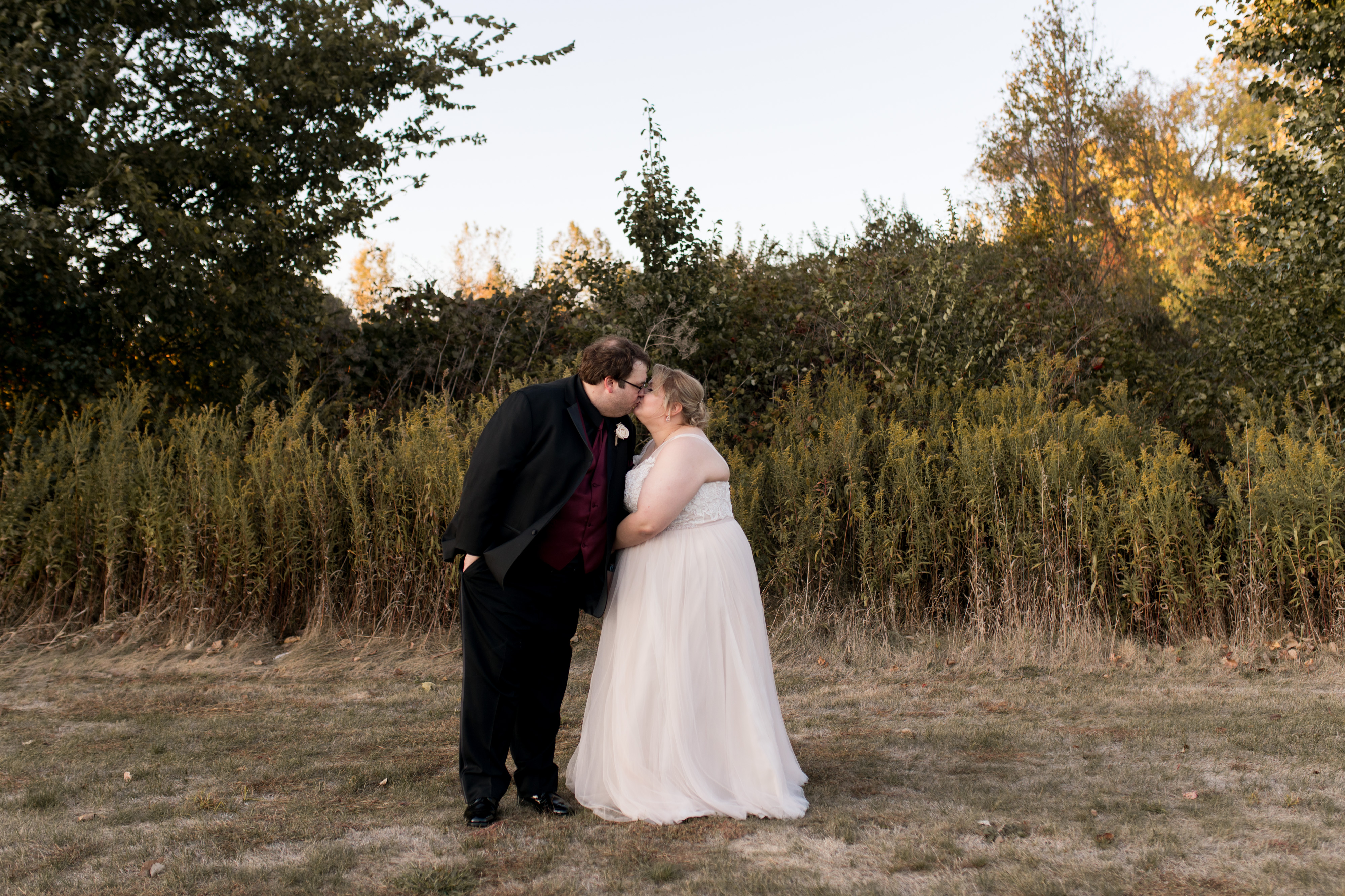 bride and groom wedding photos during sunset in Kokomo Indiana