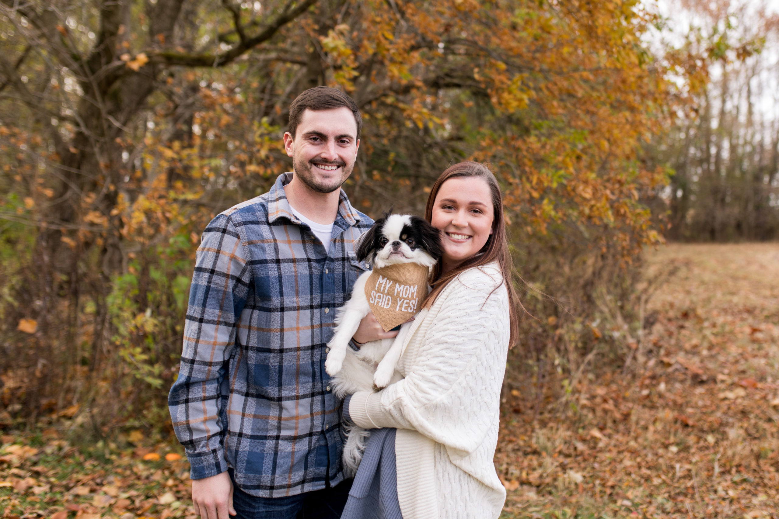 engaged couple with dog during engagement photos at Jackson Morrow Park