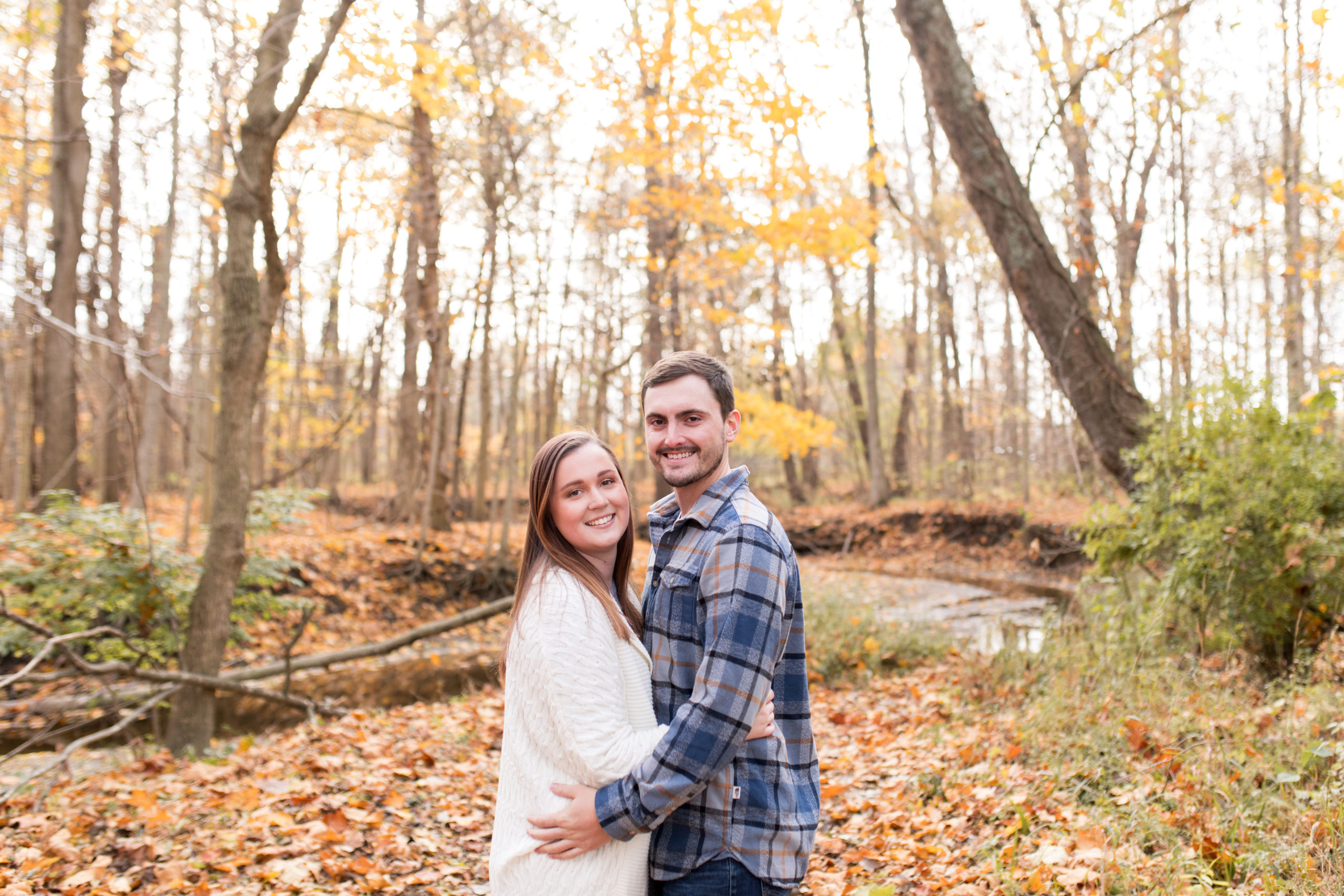 bride and groom during fall engagement Session at Jackson Morrow Park