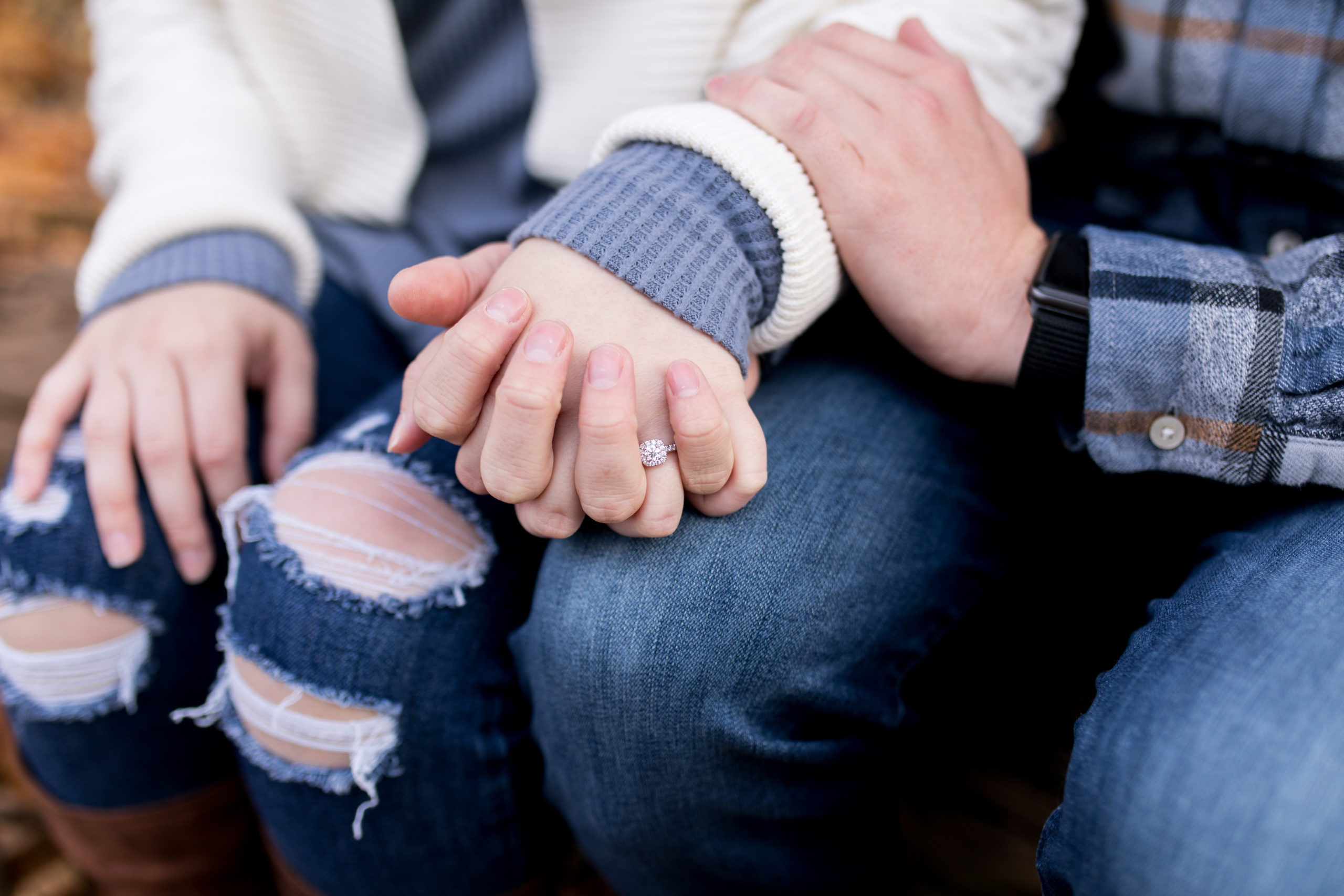 bride and groom hold hands during engagement session at Jackson Morrow Park
