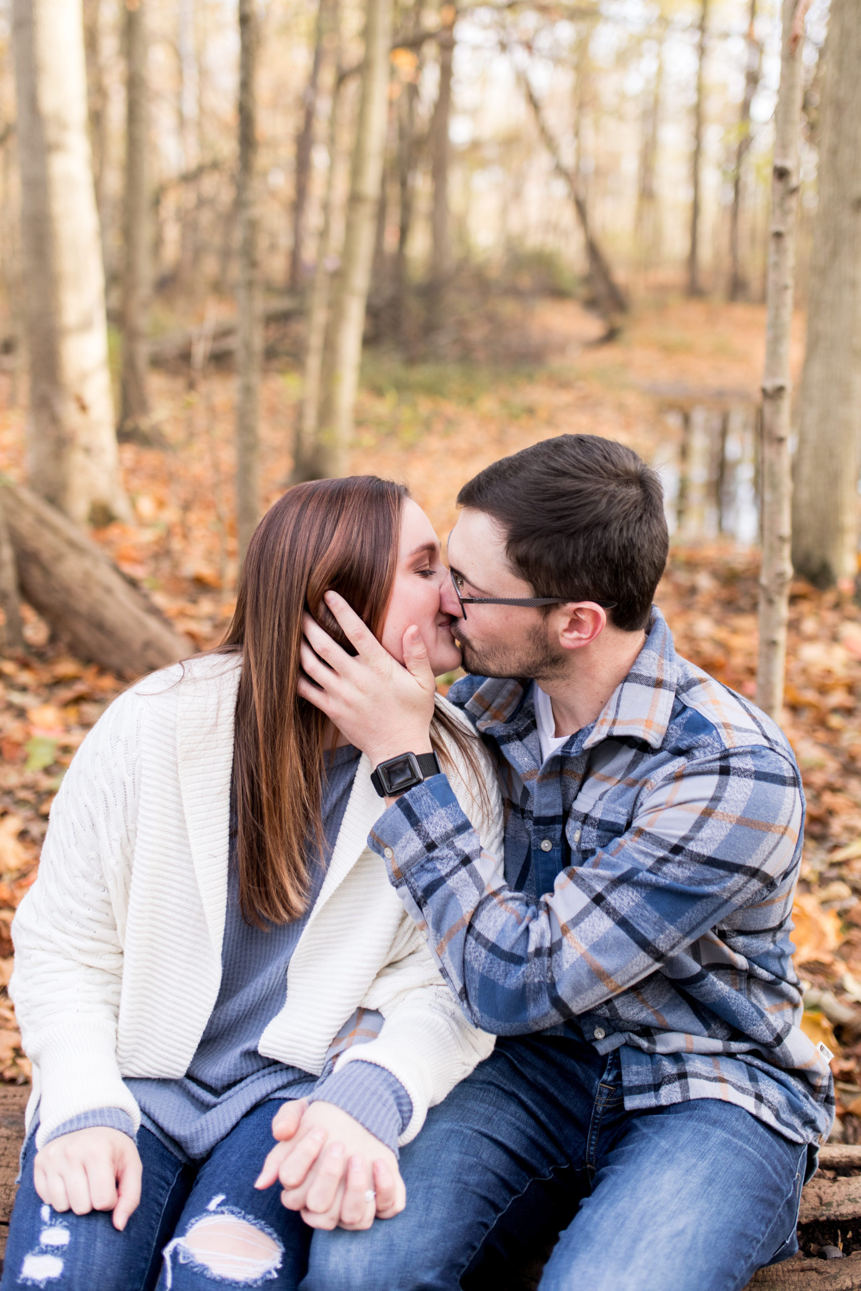 groom pulls bride in for kiss during Kokomo engagement session at Jackson Morrow Park
