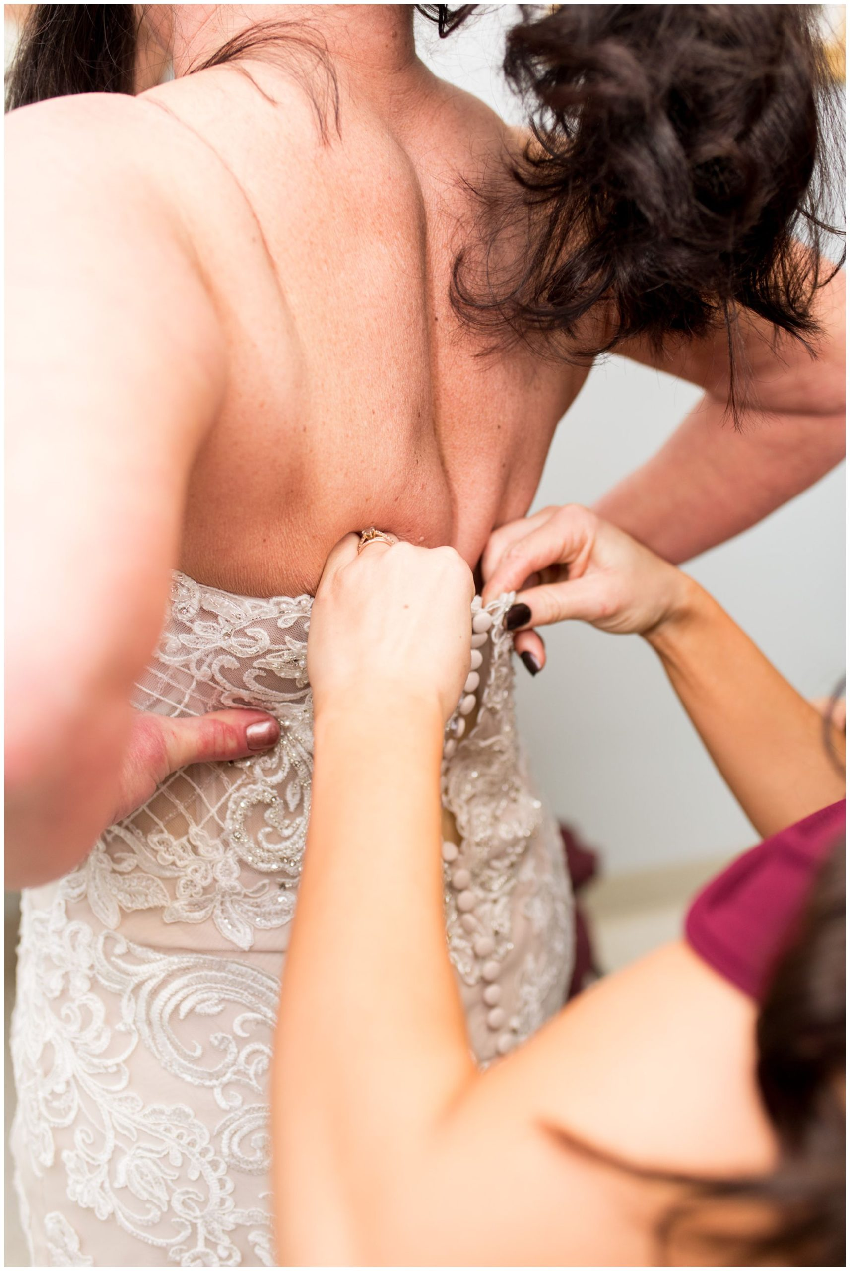 bride's daughter zips bride's dress at Zion Lutheran Church in Portland Indiana