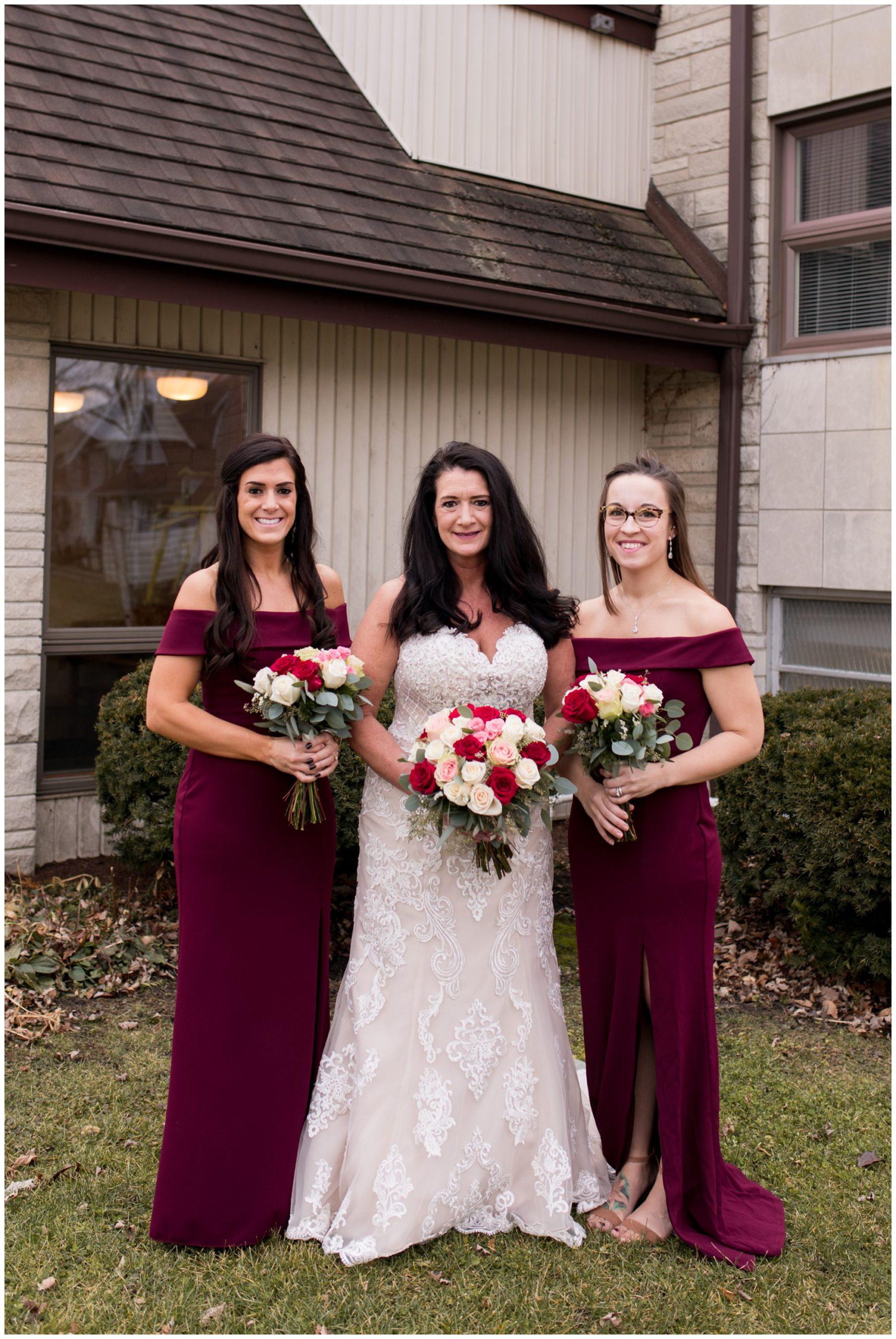 bride with bridesmaids before winter Portland Golf Club wedding in Portland Indiana