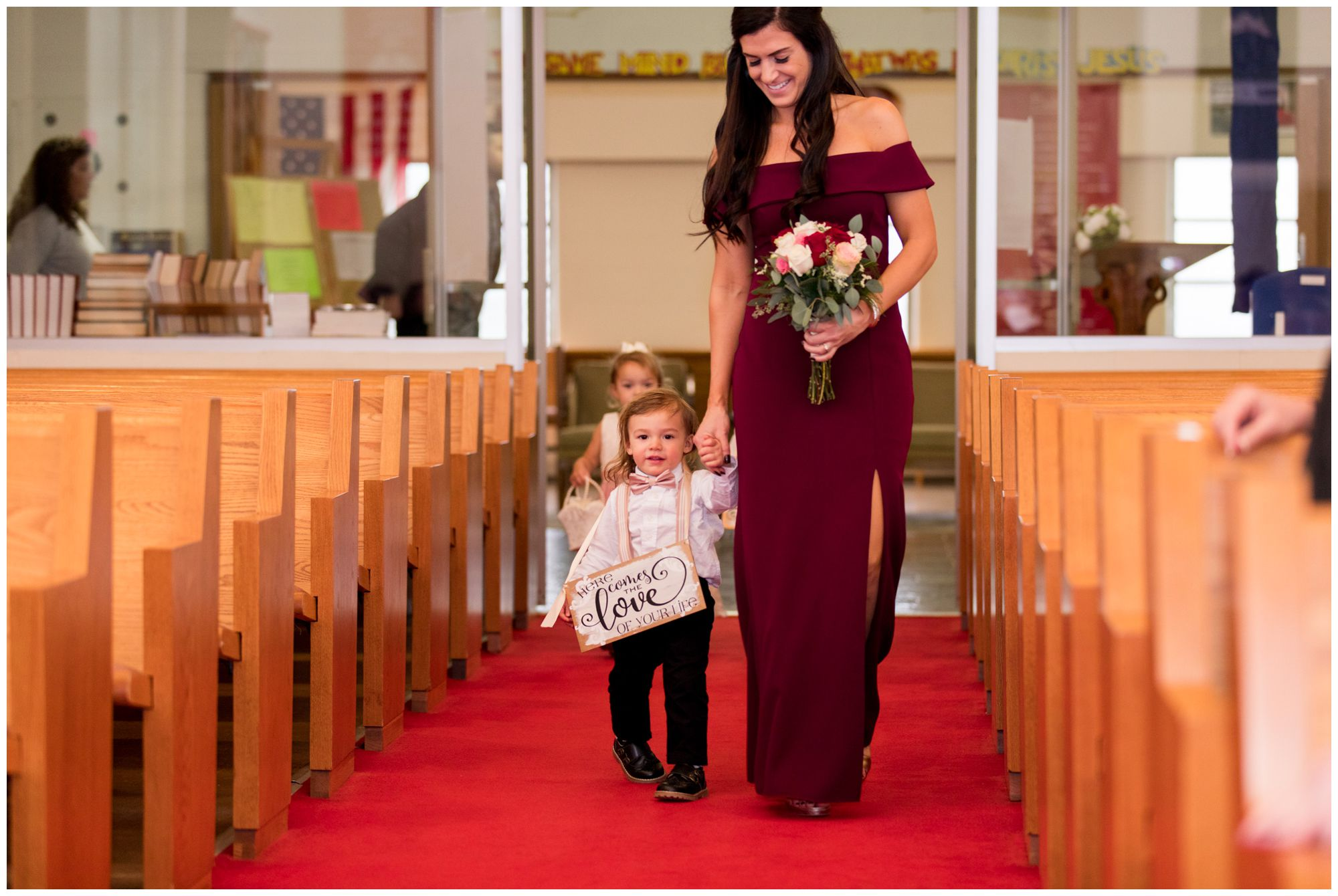 bridemaid and ring bearer walk down aisle at Zion Lutheran Church during Portland Indiana wedding