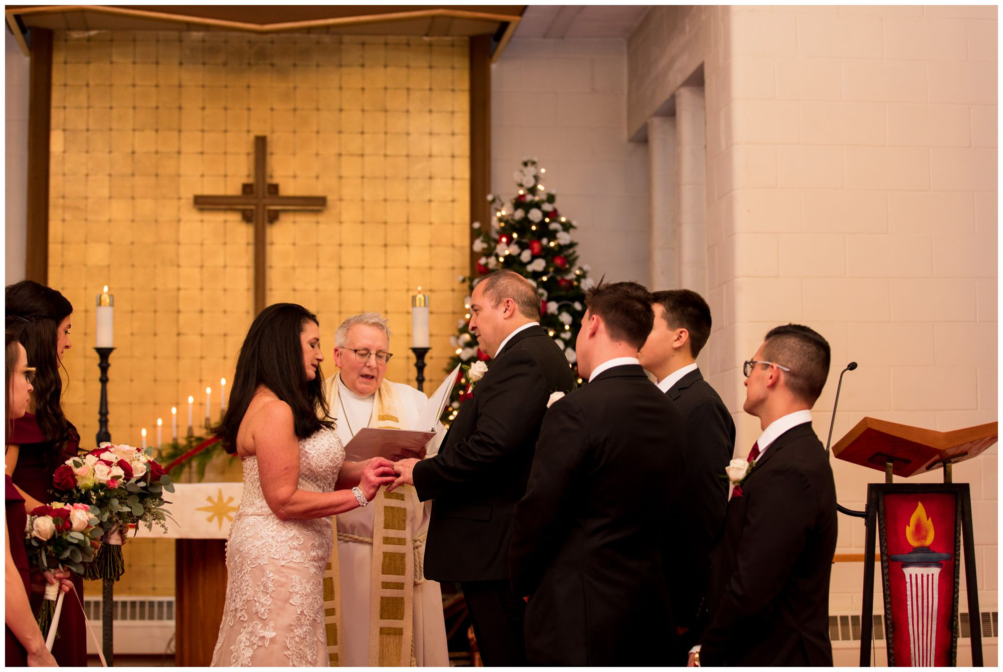 bride and groom exchange rings at Zion Lutheran Church wedding in Portland Indiana