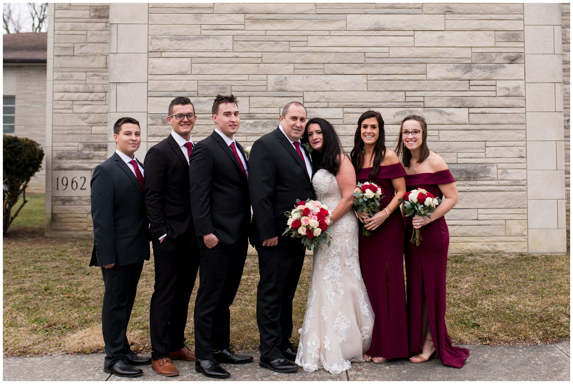 bride and groom with wedding party outside of Zion Lutheran Church in Portland Indiana
