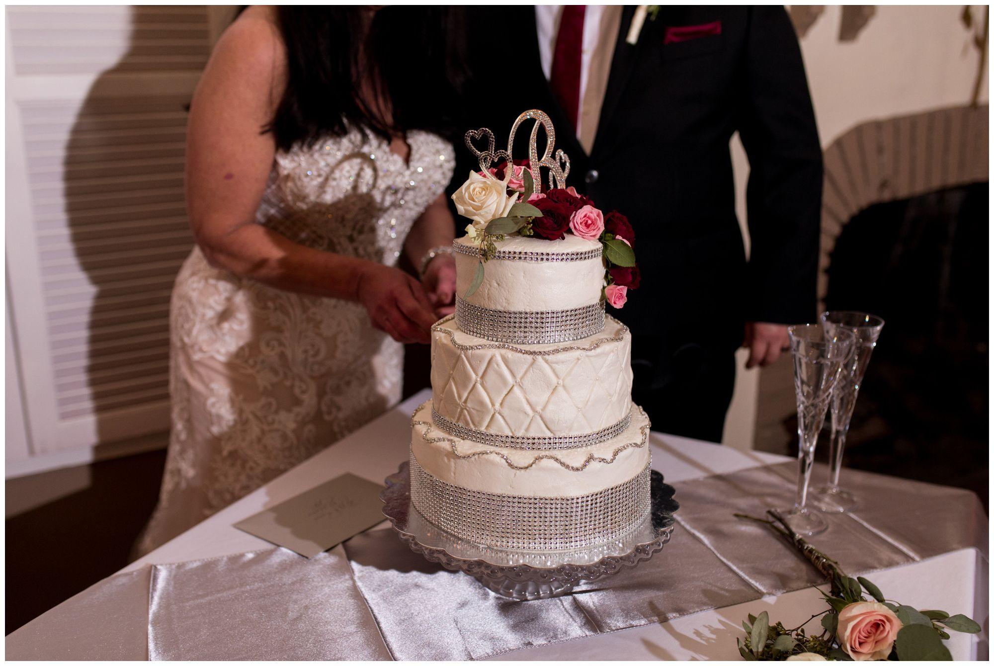 bride and groom cut wedding cake at Portland Golf Club in Portland Indiana
