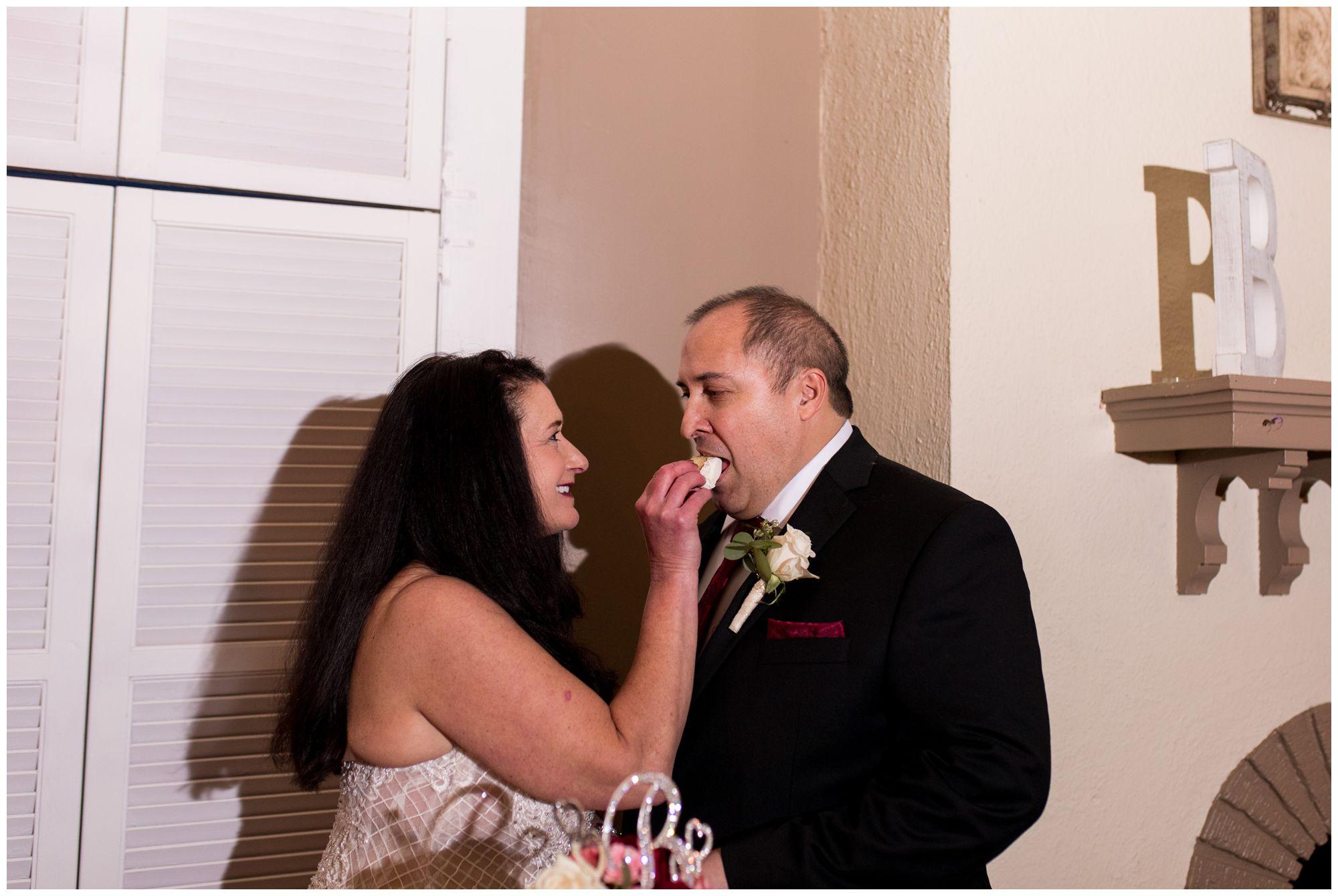 bride feeds groom wedding cake at Portland Golf Club in Portland Indiana