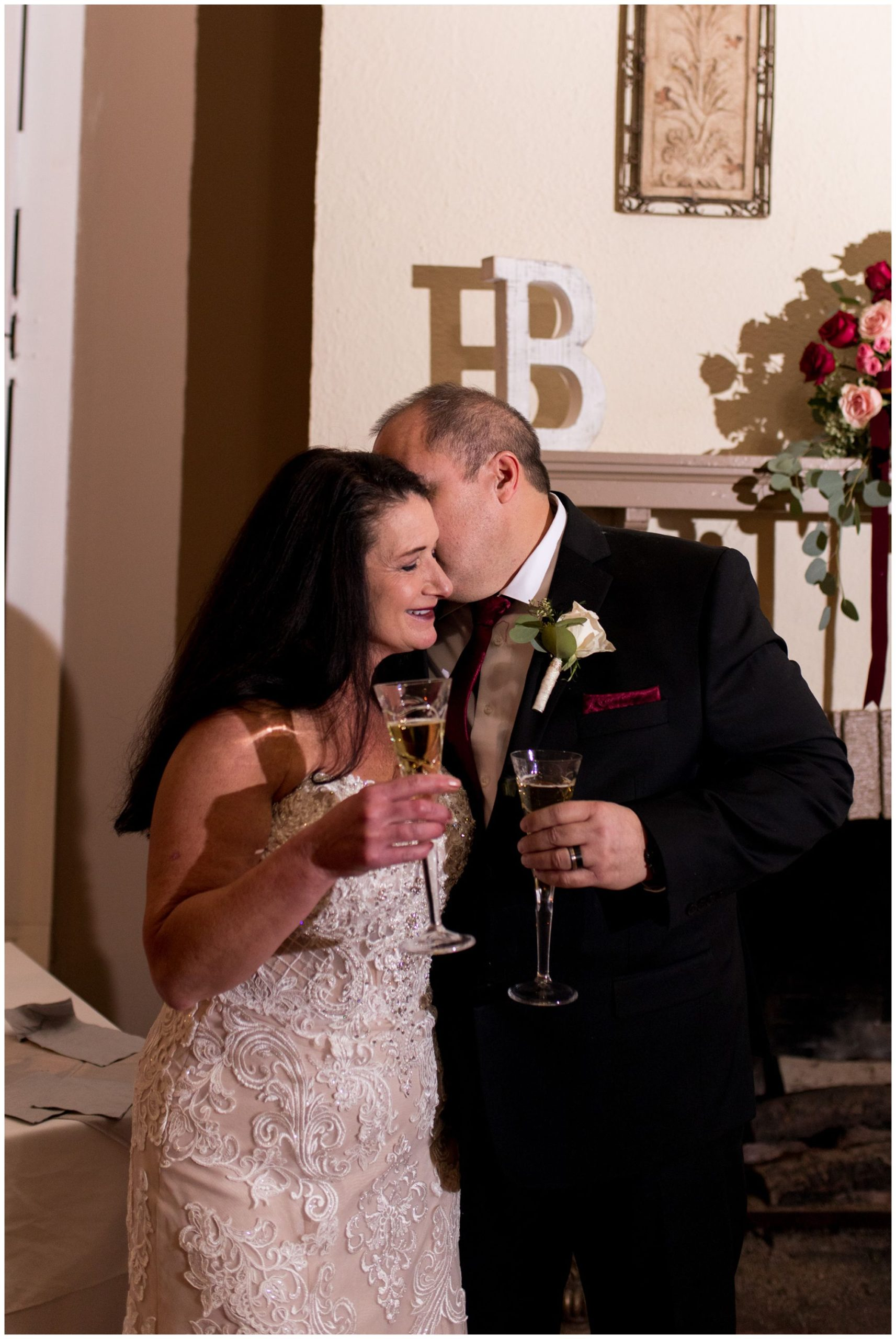 groom whispers in bride's ear during champagne toast at Portland Golf Club in Portland Indiana