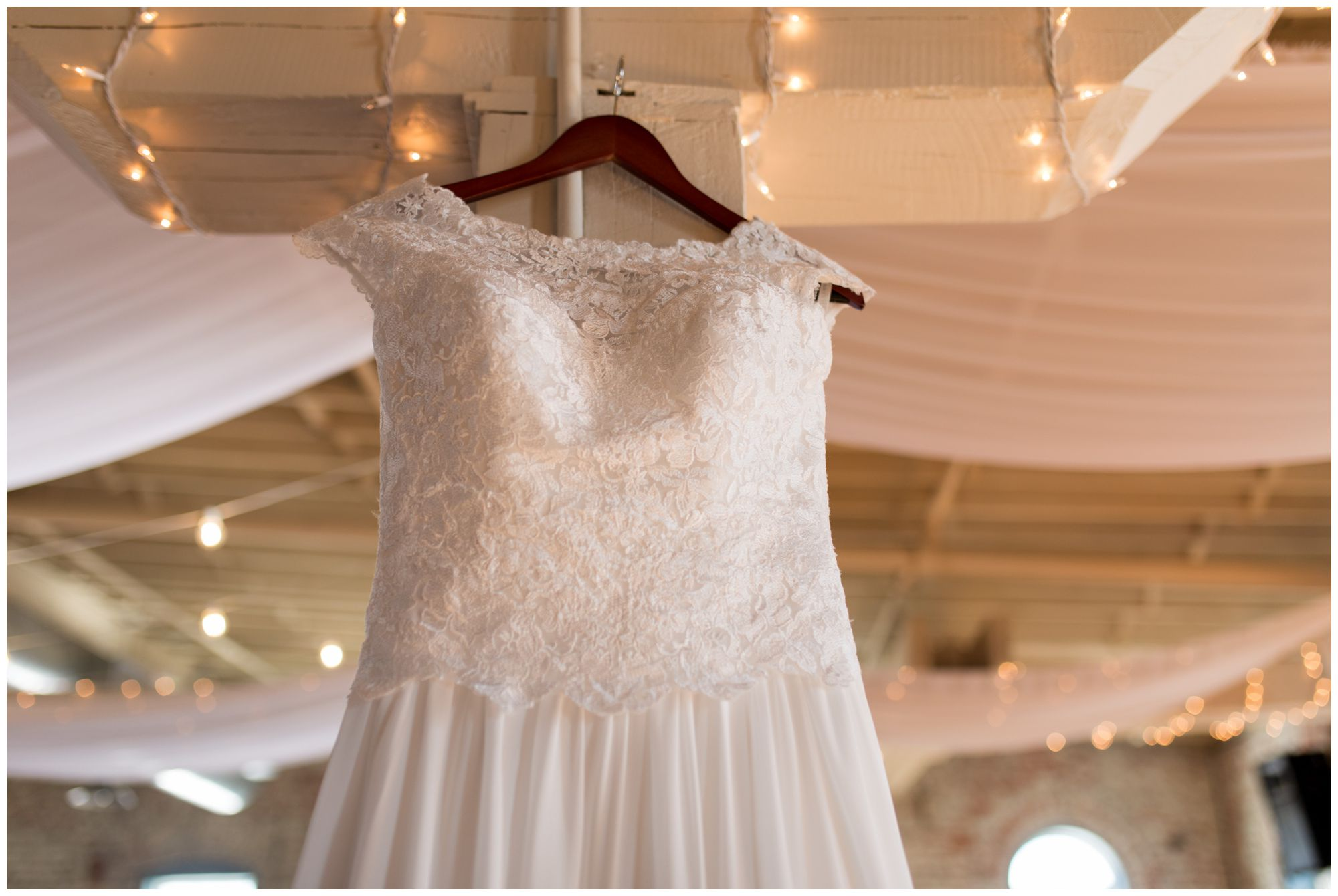 bride's dress hanging in The Gallery at Bread and Chocolate in Goshen