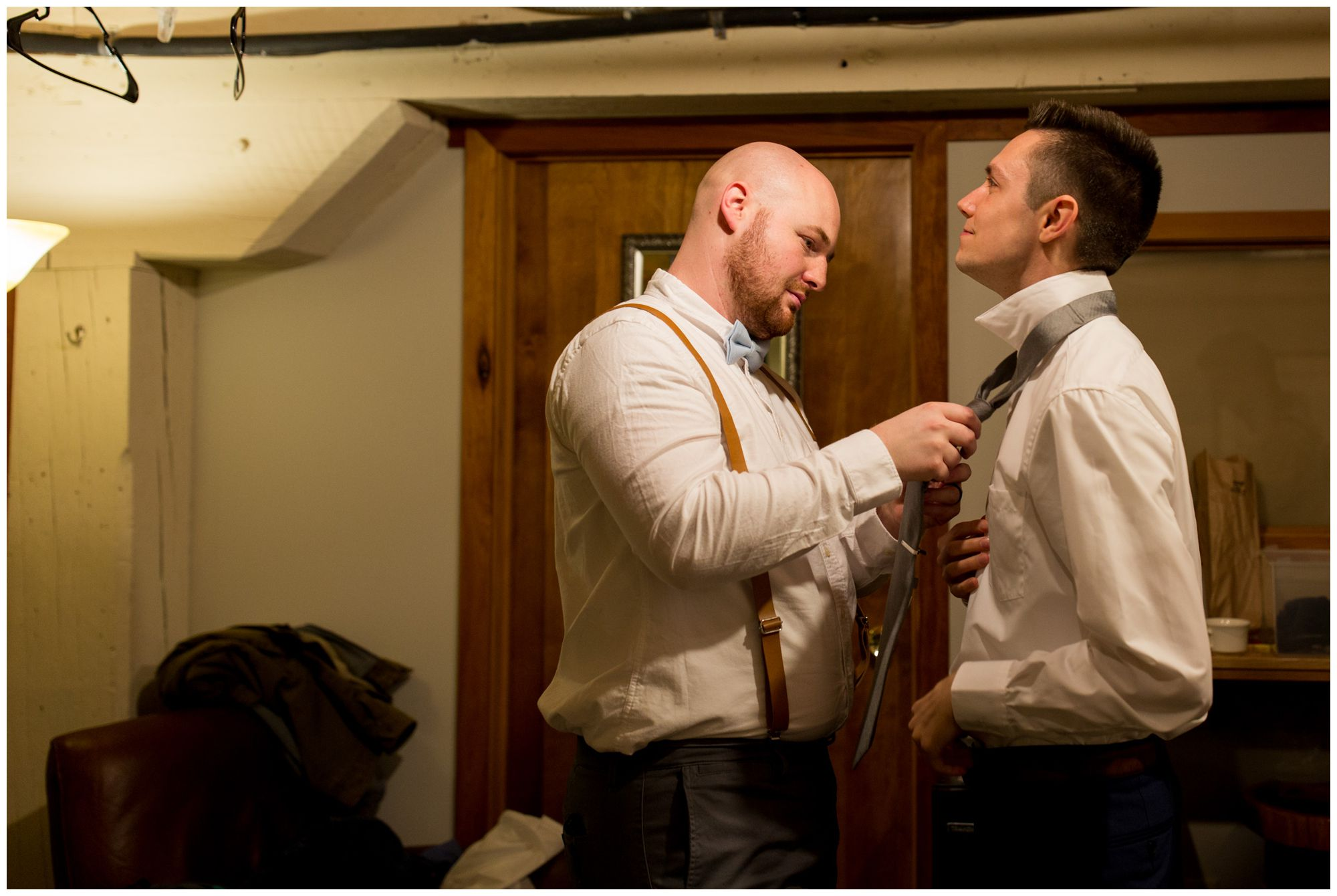 groom and best man getting ready at Bread & Chocolate in Goshen