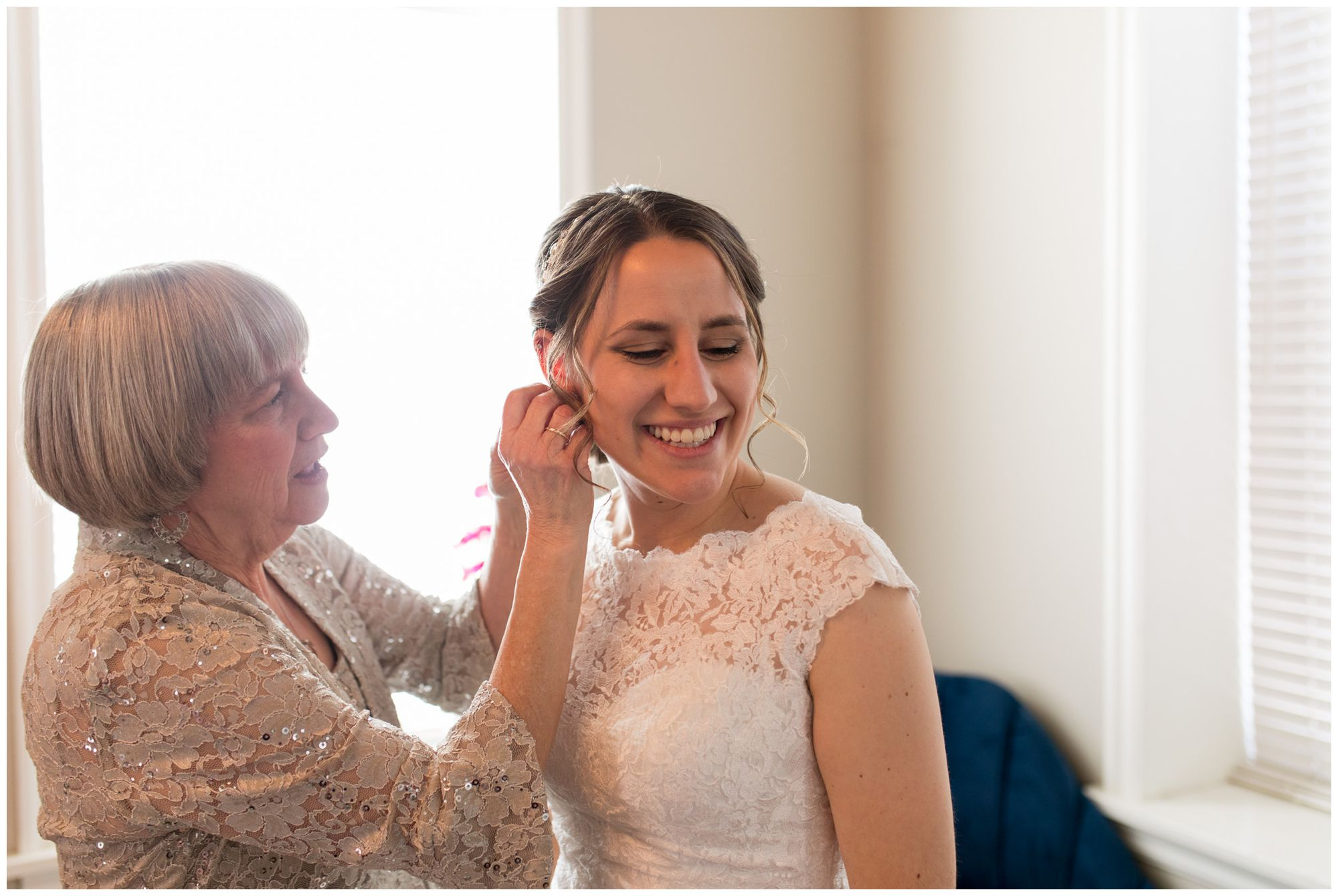 mother of bride puts in bride's earrings before wedding at Bread & Chocolate in the Old Bag Factory