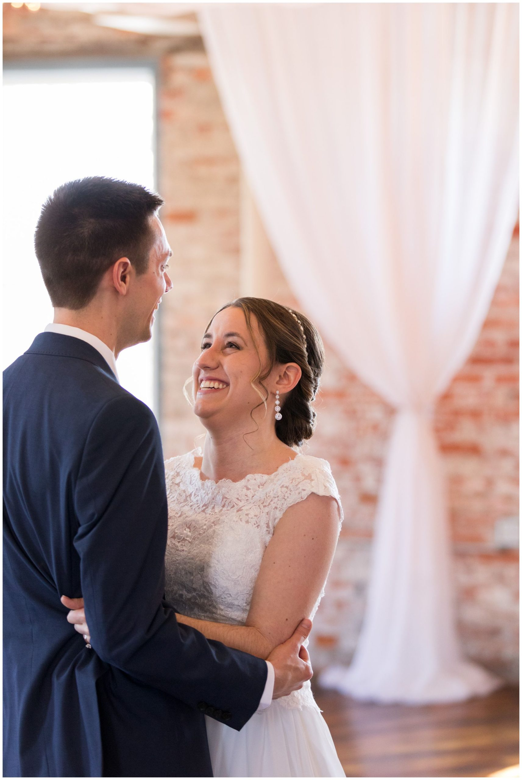 bride and groom first look in The Gallery at Bread & Chocolate in Goshen