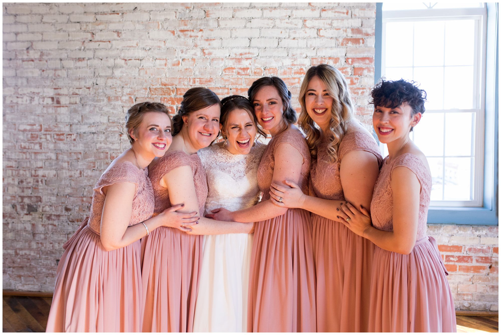 bride and bridesmaids portraits in The Gallery at Bread & Chocolate in Goshen