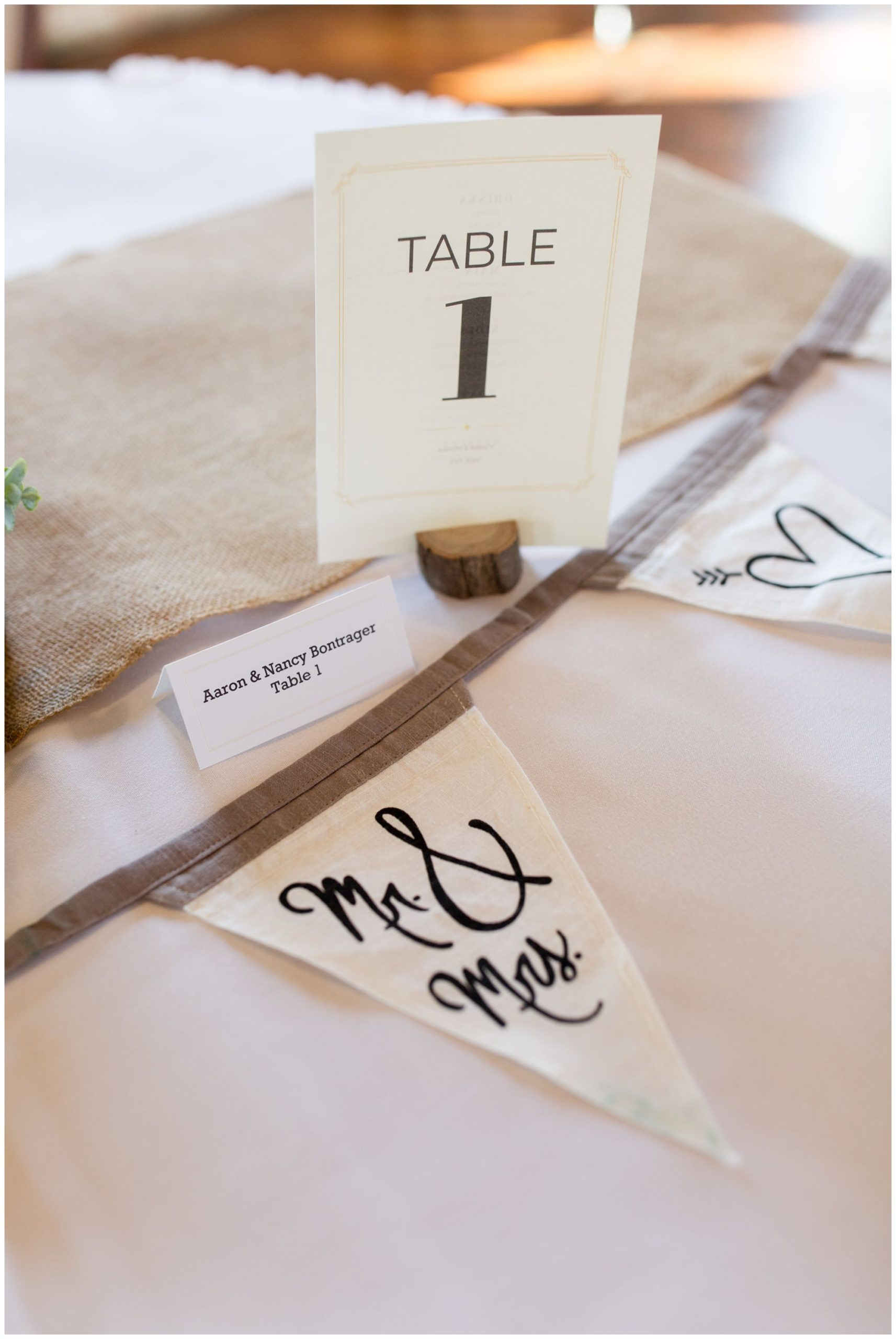 cotton wedding banner on couple's sweetheart table at Bread & Chocolate wedding venue