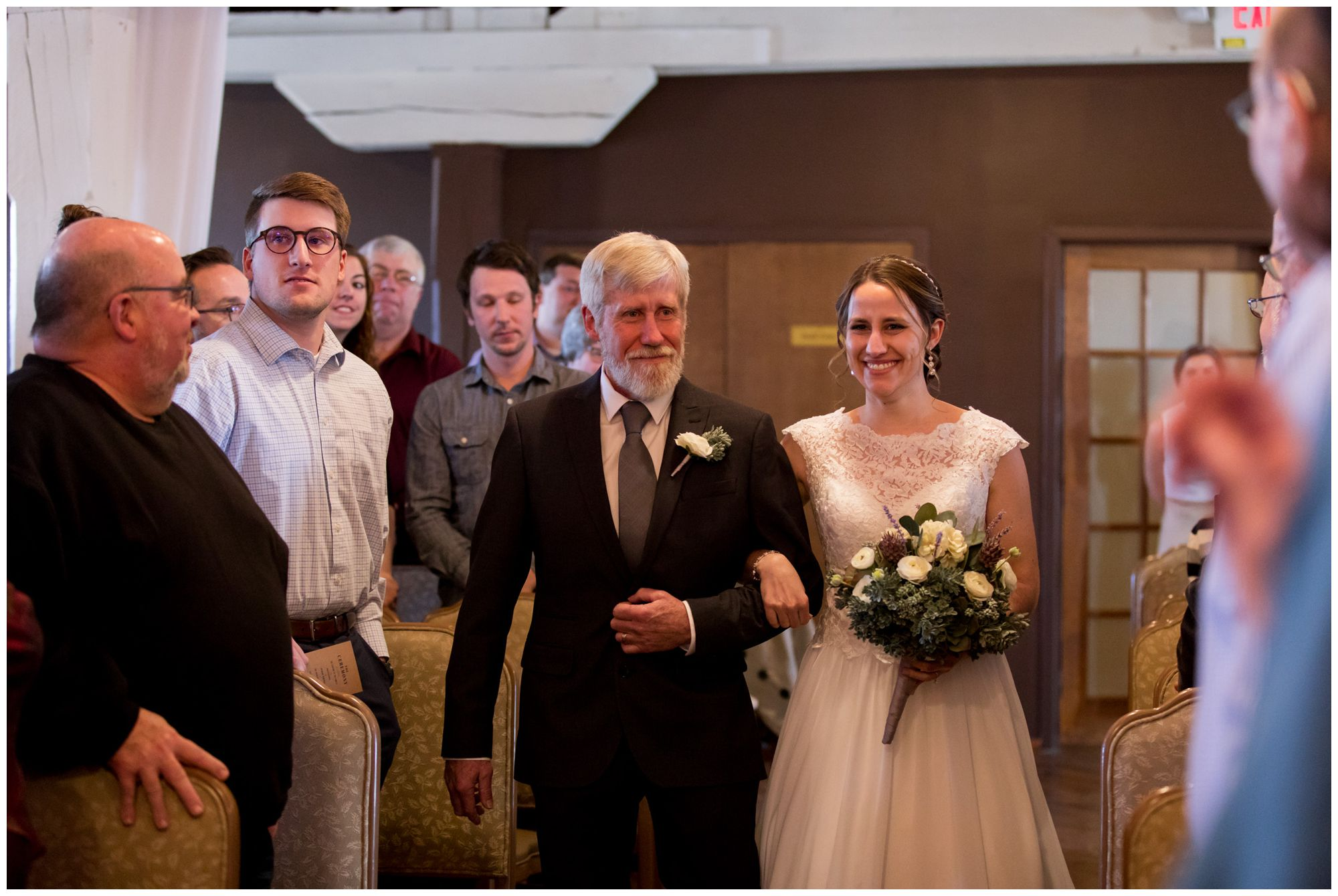 bride walks down aisle with father during Goshen wedding ceremony