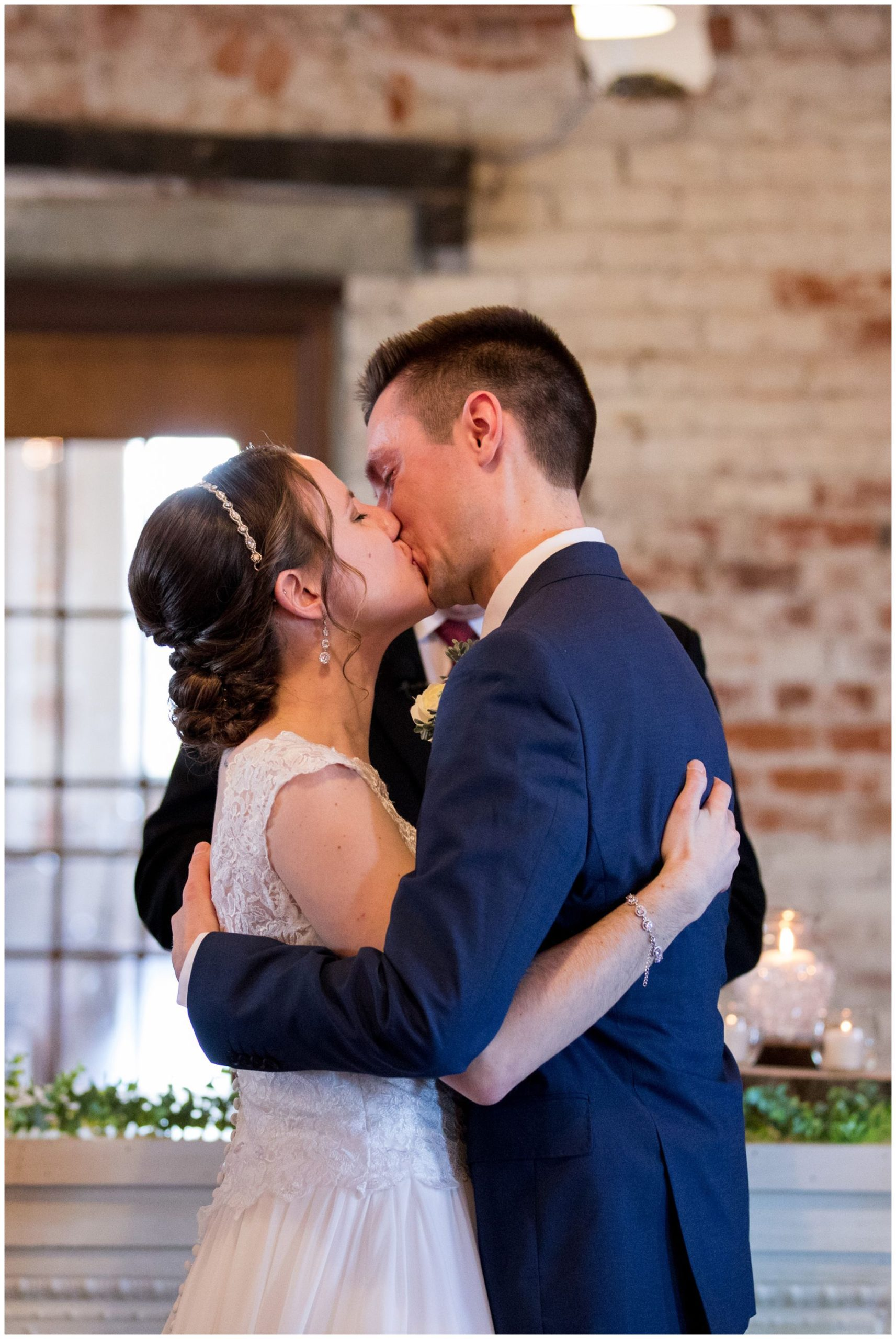 bride and groom wedding ceremony first kiss in Goshen Indiana