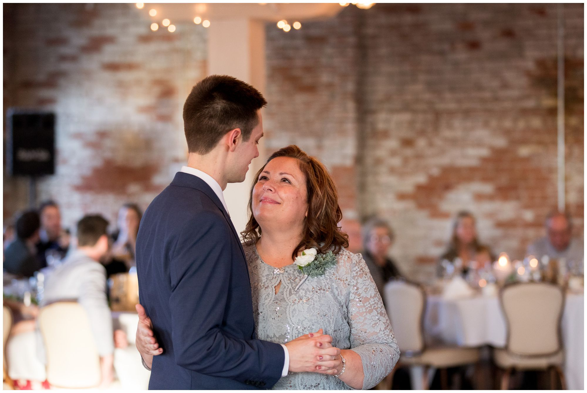 groom and mother dance together during Bread & Chocolate wedding reception